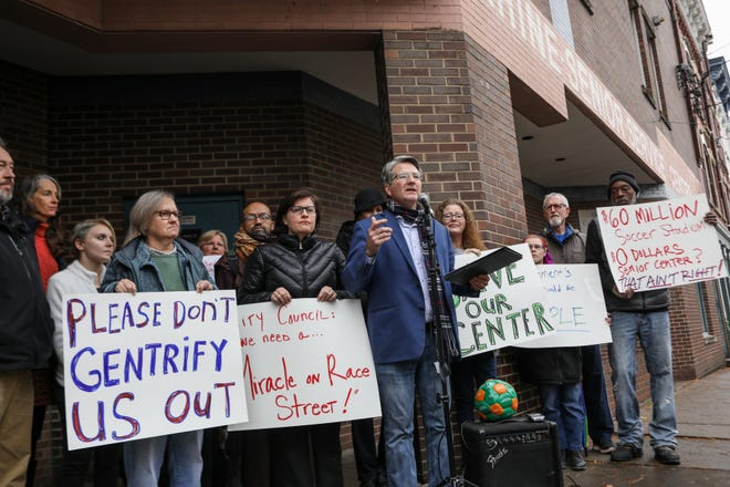 Brian Garry leads a rally outside of the OTR Senior Citizen Center in protest of its Nov. 28 closing.