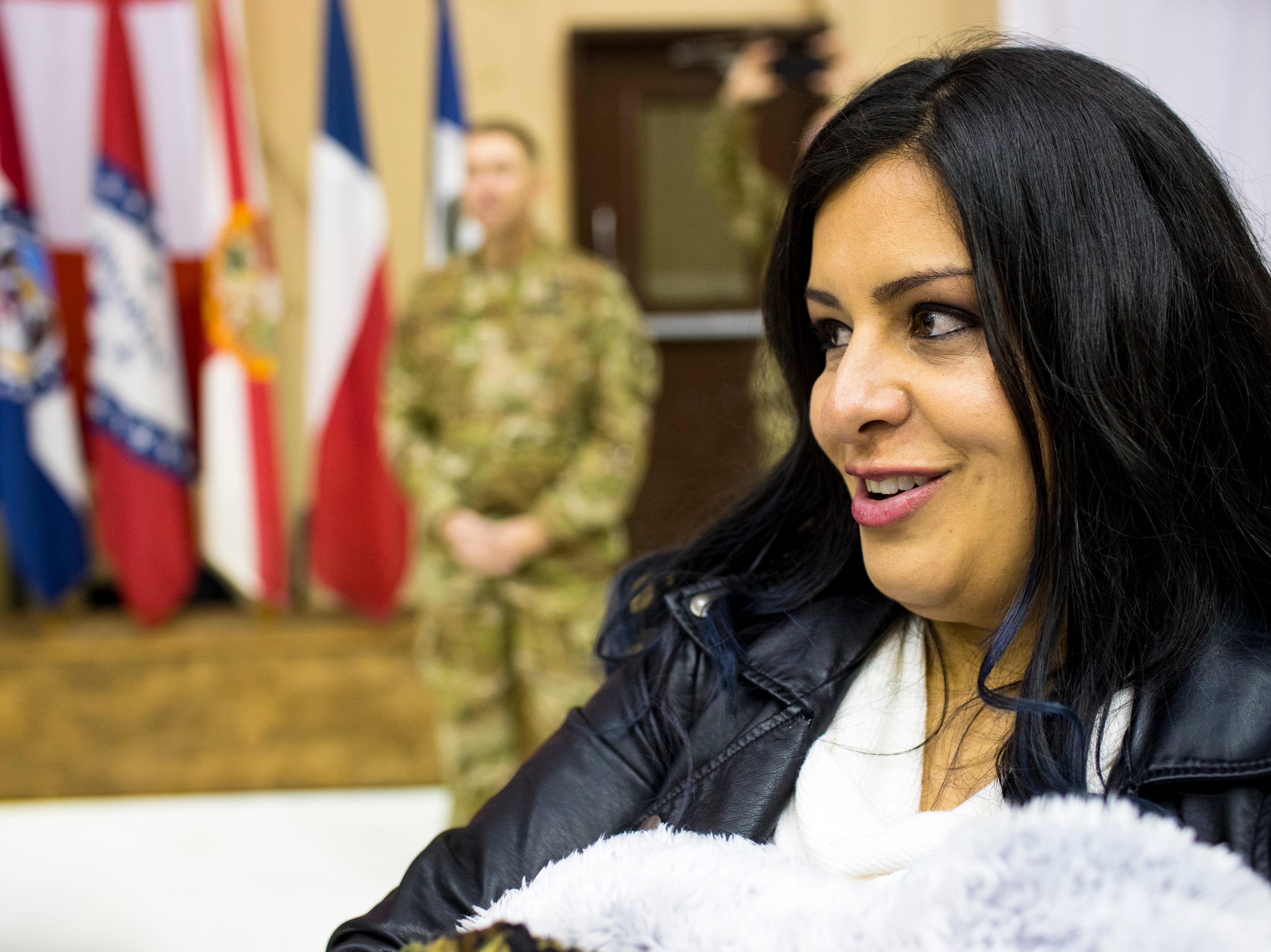 Elizabeth Peterson prepares to greet her husband, Sgt. Major Kevin Peterson during the welcome home ceremony for the 2nd Battalion, 44th Air Defense Artillery Regiment and 101st Airborne Division at Fort Campbell in the early hours of Monday, Nov. 19, 2018. The soldiers were returning from a 9-month deployment in Afghanistan.