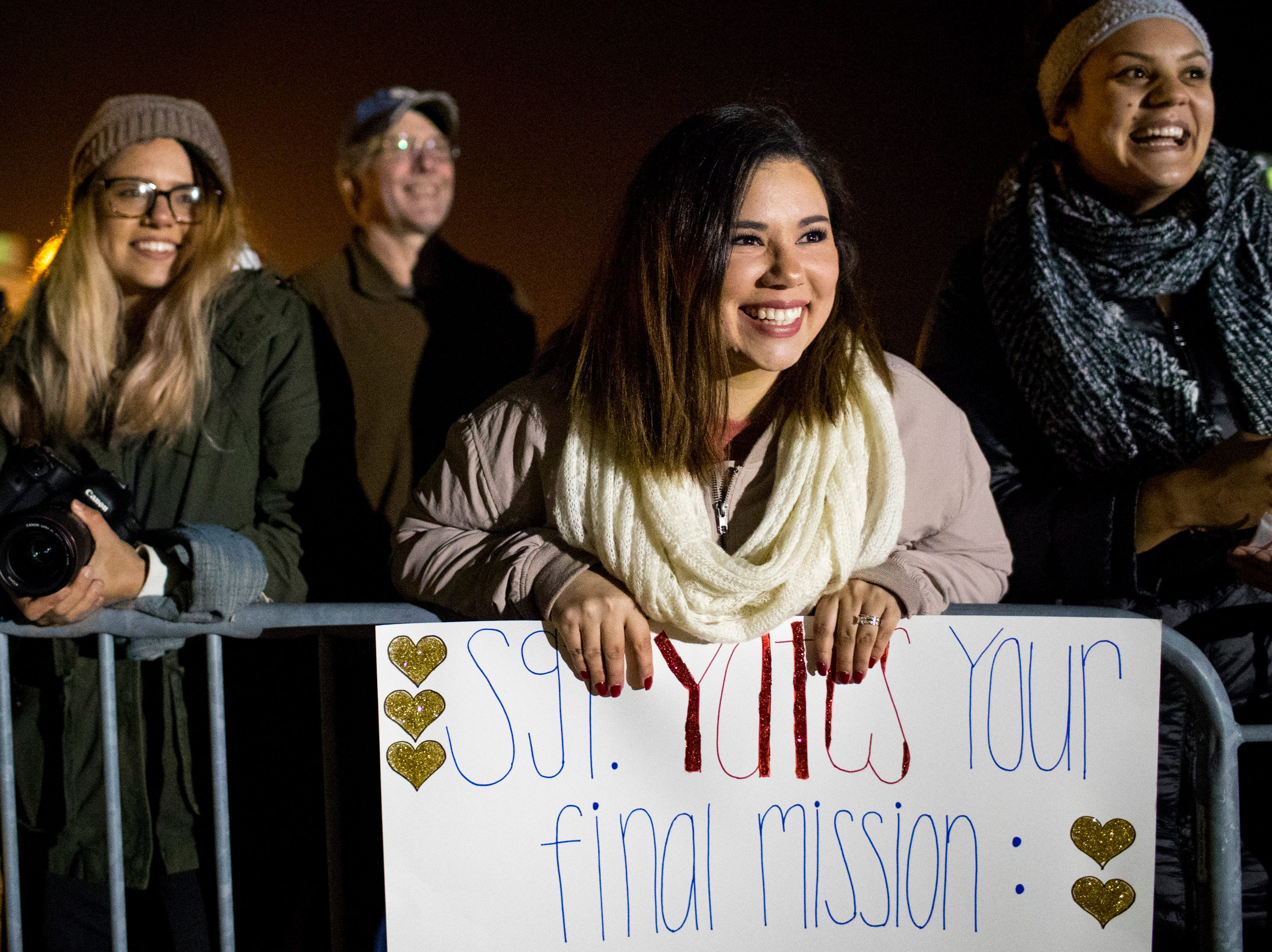 Felicia Yates smiles as she watches her husband, Sgt. Nicholas Yates, deplane during the welcome home ceremony for the 2nd Battalion, 44th Air Defense Artillery Regiment and 101st Airborne Division at Fort Campbell in the early hours of Monday, Nov. 19, 2018. The soldiers were returning from a 9-month deployment in Afghanistan.