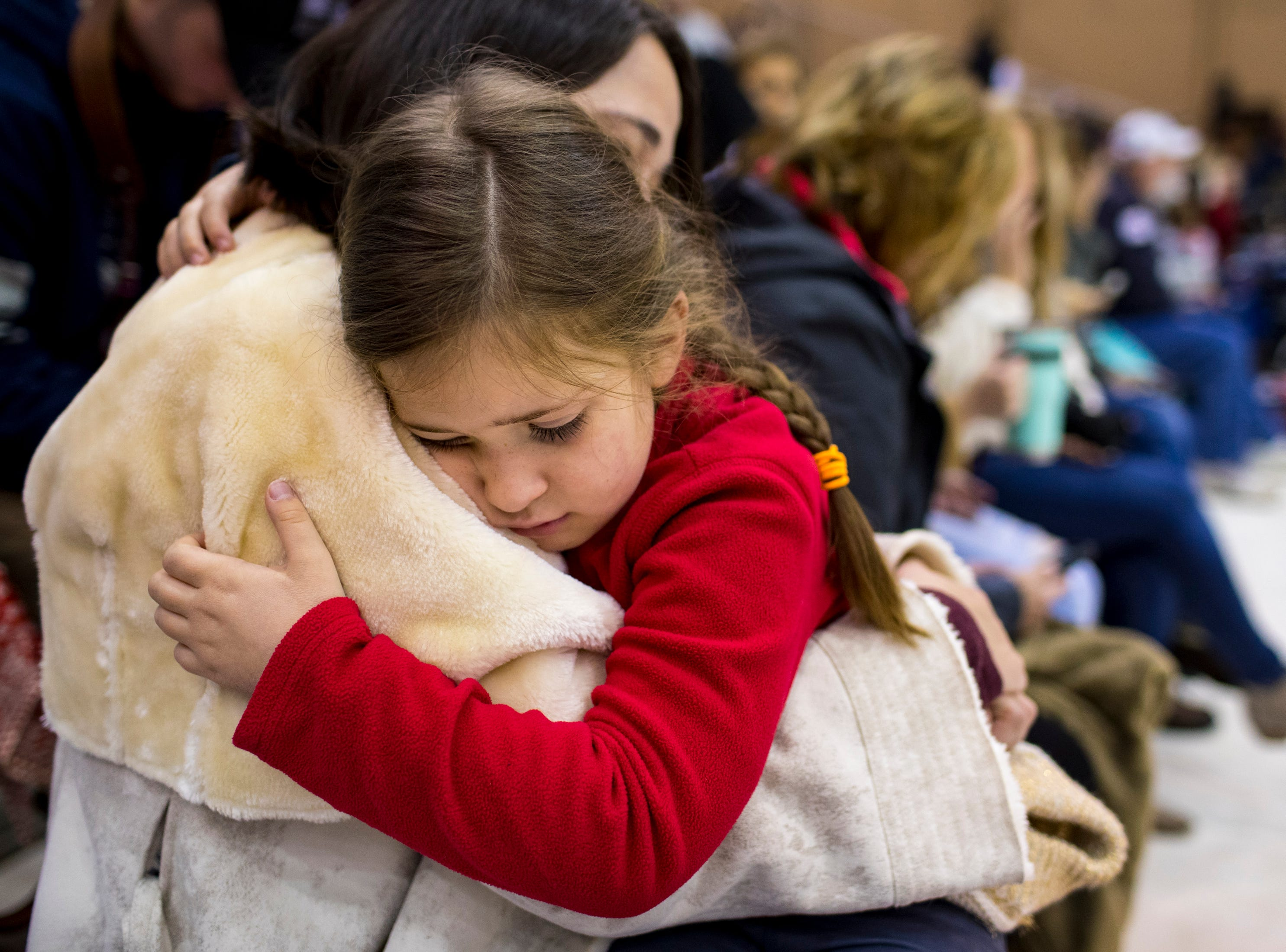 Katsiaryna Quandt holds her daughter Valentina Quandt, 6, while waiting for 1st Lt. Daniel Quandt to arrive during the welcome home ceremony for the 2nd Battalion, 44th Air Defense Artillery Regiment and 101st Airborne Division at Fort Campbell in the early hours of Monday, Nov. 19, 2018. The soldiers were returning from a 9-month deployment in Afghanistan.