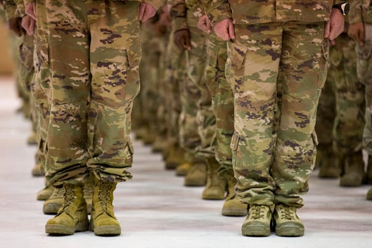 Members of the 2nd Battalion, 44th Air Defense Artillery Regiment and 101st Airborne Division stand in formation during a welcome home ceremony at Fort Campbell in the early hours of Monday, Nov. 19, 2018. The soldiers were returning from a 9-month deployment in Afghanistan.