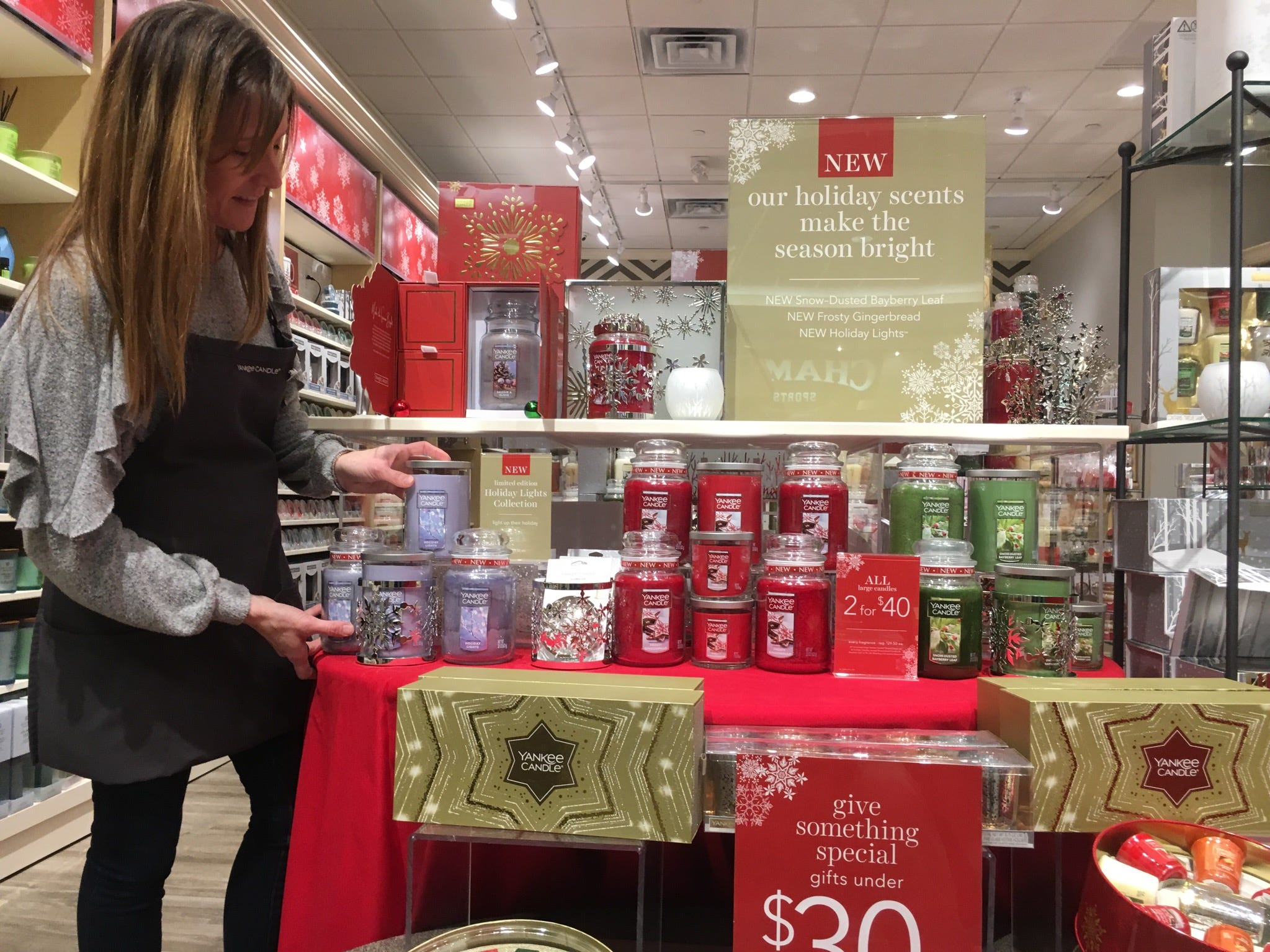 Yankee Candle is another one of the newer Governor's Square stores. Store manager Kristie Montjoy shows a Christmas candle display.