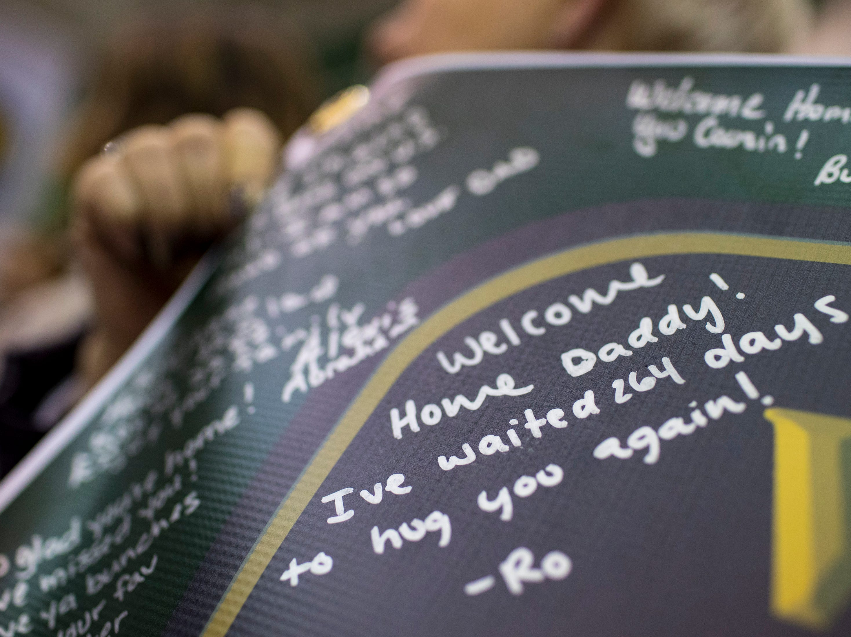 A welcome home note for Specialist Dustin Mattox from his son Rowan Mattox, is written on a banner held by Specialist Mattox's family, during the welcome home ceremony for the 2nd Battalion, 44th Air Defense Artillery Regiment and 101st Airborne Division at Fort Campbell in the early hours of Monday, Nov. 19, 2018. The soldiers were returning from a 9-month deployment in Afghanistan.