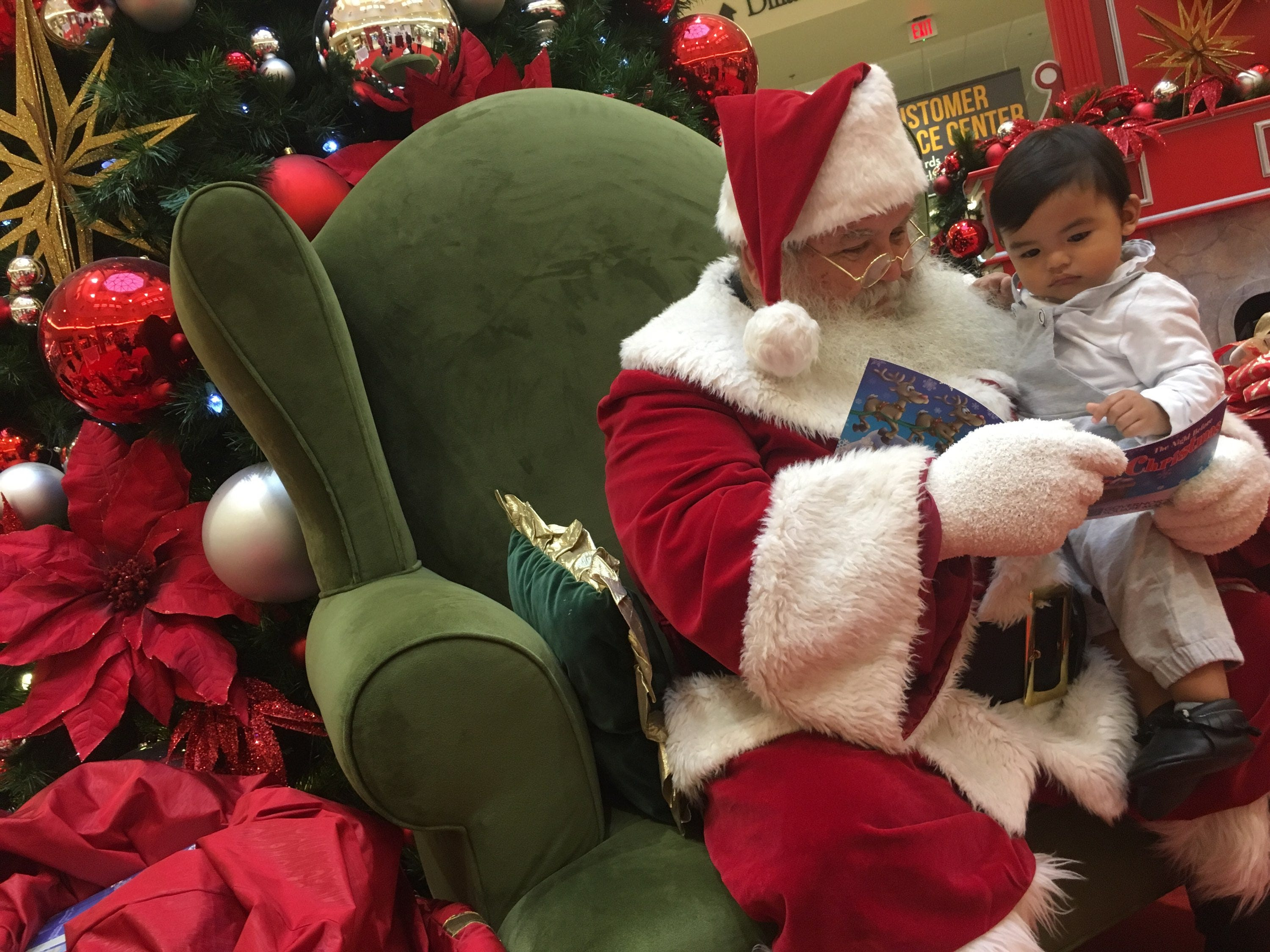 Santa is already taking orders for Christmas Eve delivery at Clarksville's Governor's Square Mall. Here he gets a visit from one-year-old Roman Bayran.