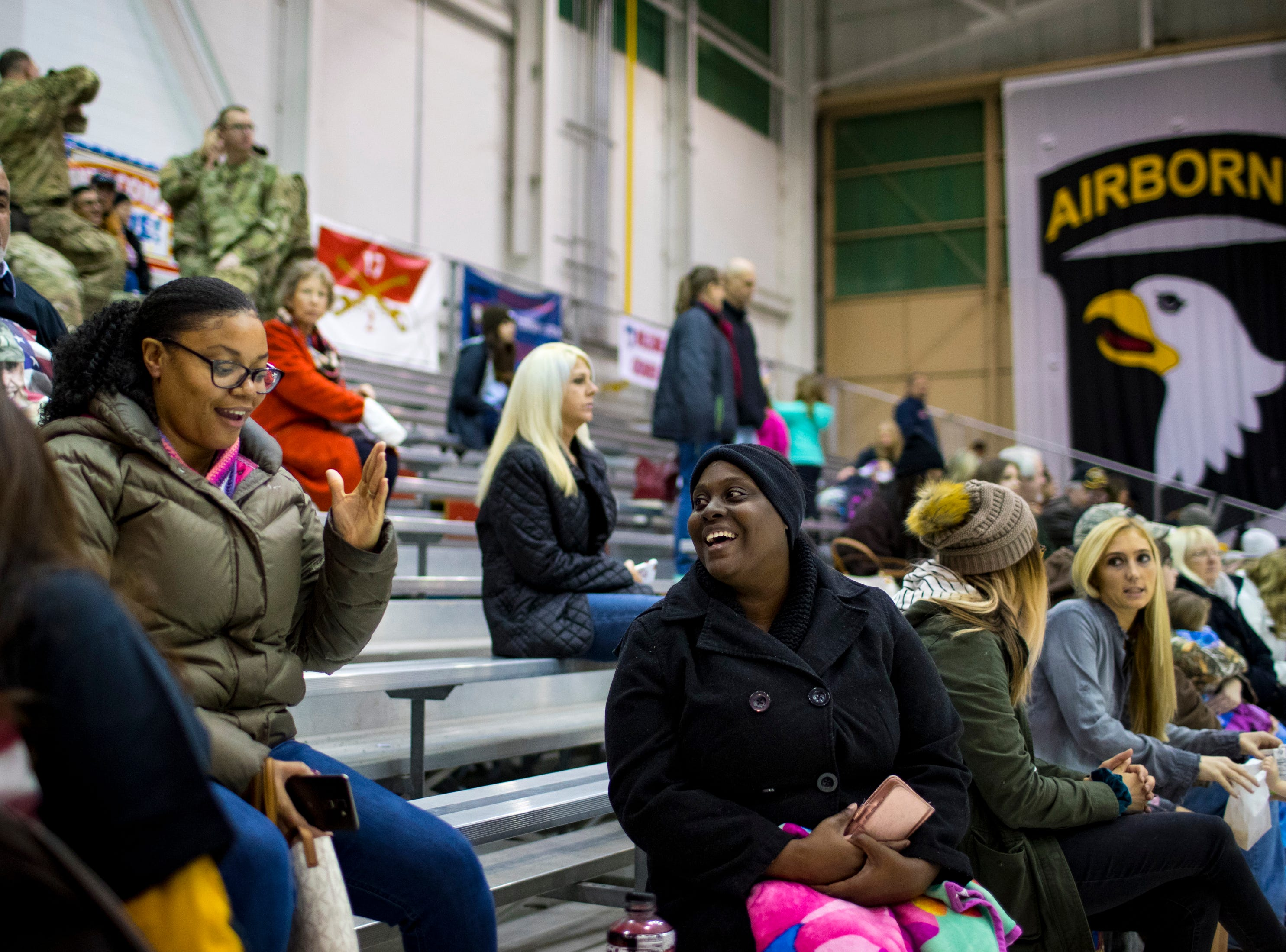 Bridgett Hill and Jasmine Turner chat while waiting for the plane carrying their husbands, Sgt. Jerry Hill and Sgt. 1st Class Wesley Turner, to arrive during the welcome home ceremony for the 2nd Battalion, 44th Air Defense Artillery Regiment and 101st Airborne Division at Fort Campbell in the early hours of Monday, Nov. 19, 2018. The soldiers were returning from a 9-month deployment in Afghanistan.