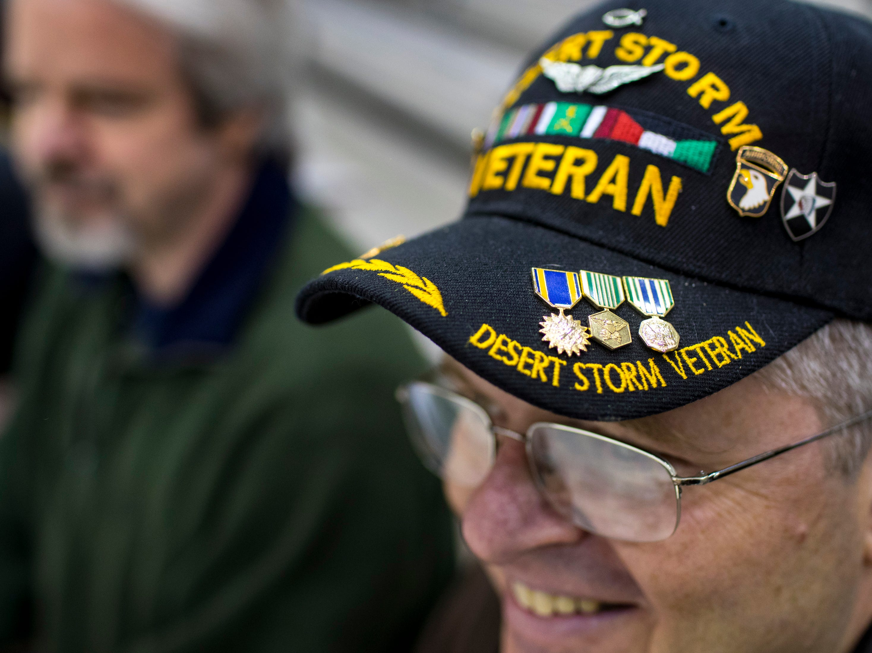 Olaf Marek wears a Desert Storm veteran hat while waiting for his nephew, 2nd Lt. Nick Marek to arrive during the welcome home ceremony for the 2nd Battalion, 44th Air Defense Artillery Regiment and 101st Airborne Division at Fort Campbell in the early hours of Monday, Nov. 19, 2018. The soldiers were returning from a 9-month deployment in Afghanistan.