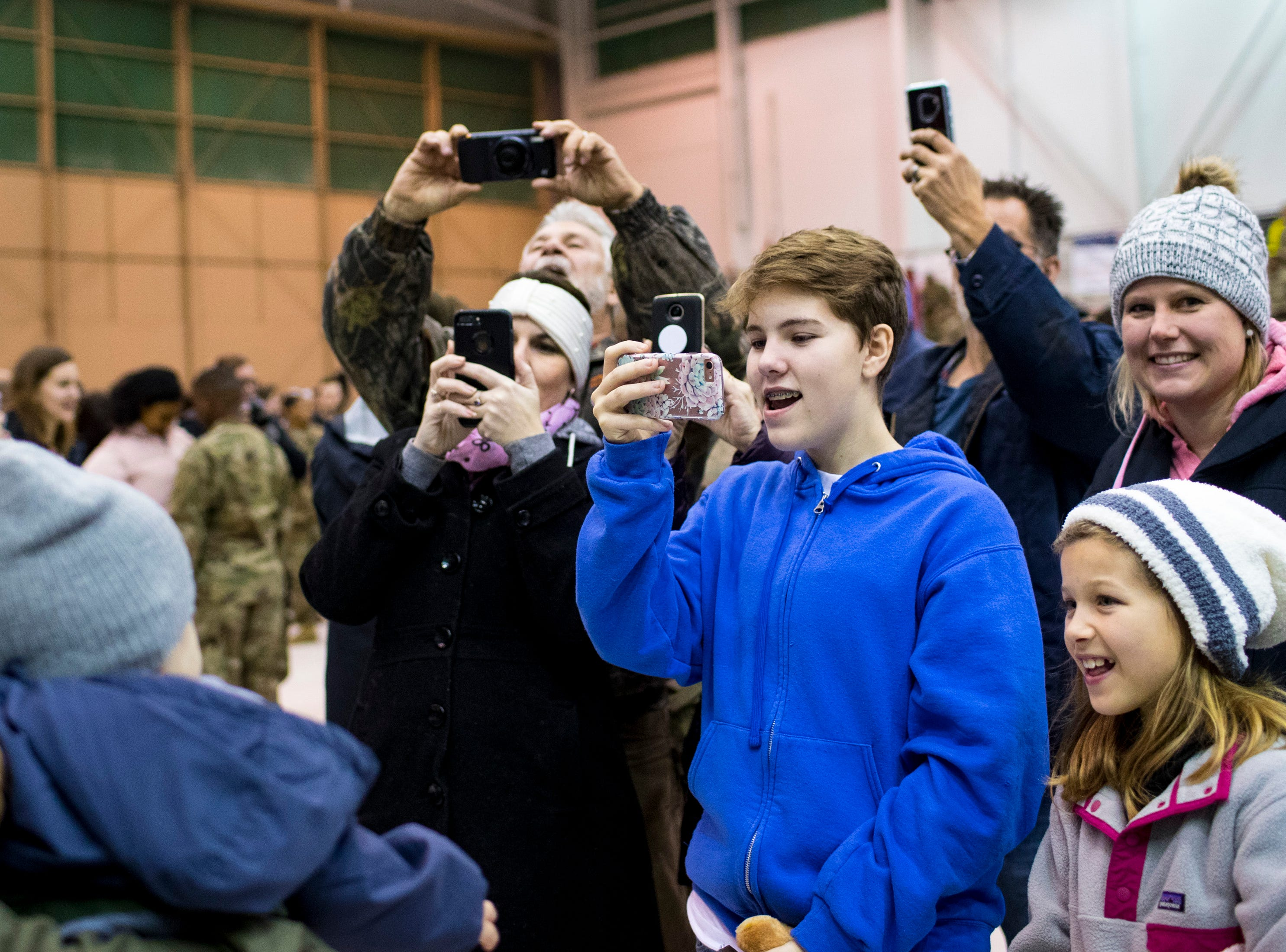 Friends and family members take pictures during the welcome home ceremony for the 2nd Battalion, 44th Air Defense Artillery Regiment and 101st Airborne Division at Fort Campbell in the early hours of Monday, Nov. 19, 2018. The soldiers were returning from a 9-month deployment in Afghanistan.