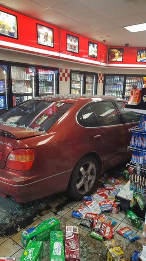 A car crashed into a building on Ashland City Road Sunday night, Nov. 18, 2018.