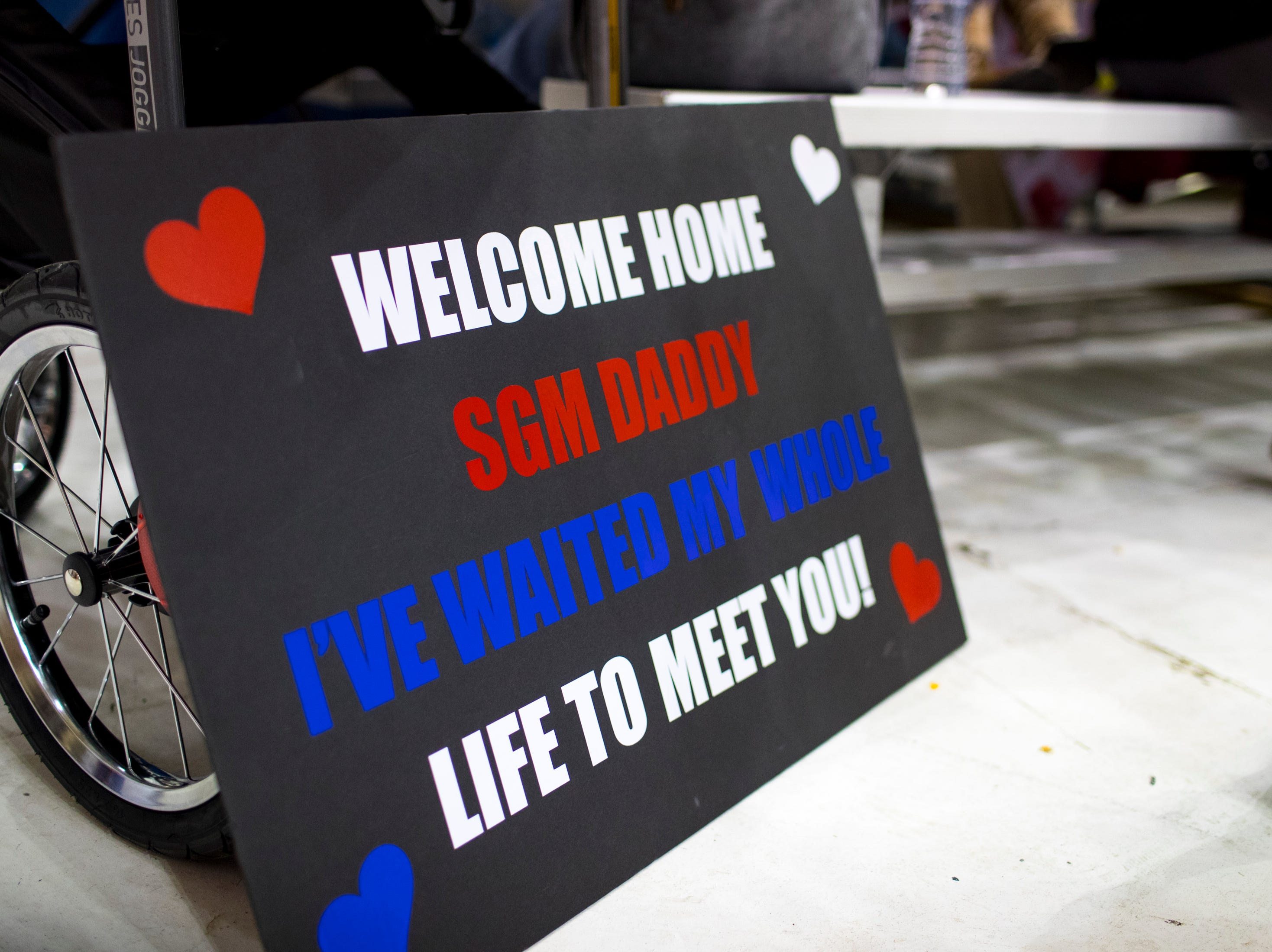A sign is ready to welcome home Sgt. Major Kevin Peterson, who will see his newborn son, Logan Grey Peterson, 1 week, for the first time during the welcome home ceremony for the 2nd Battalion, 44th Air Defense Artillery Regiment and 101st Airborne Division at Fort Campbell in the early hours of Monday, Nov. 19, 2018. The soldiers were returning from a 9-month deployment in Afghanistan.