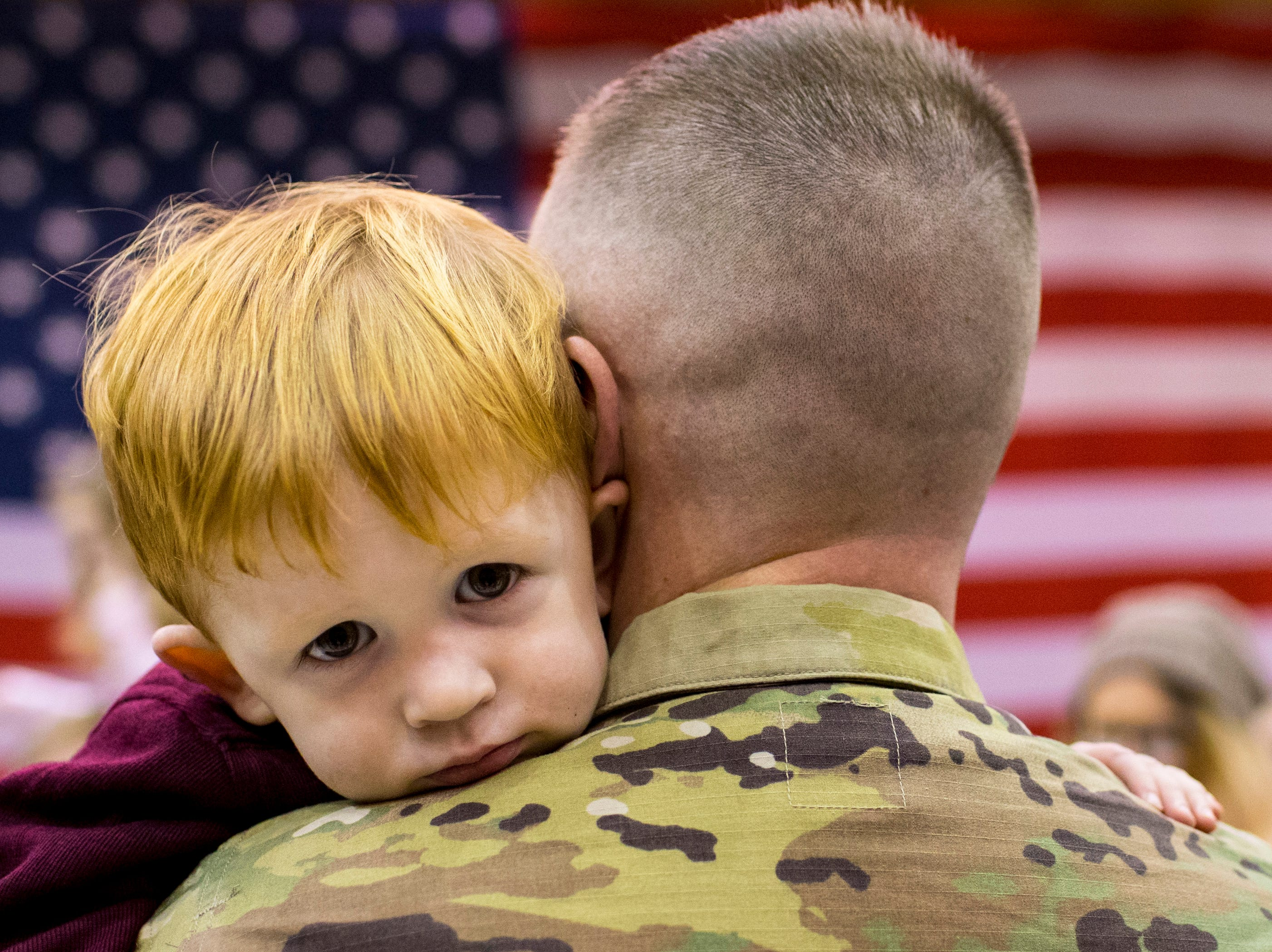 Capt. Ryan Smith holds Wyatt Smith, 2, during the welcome home ceremony for the 2nd Battalion, 44th Air Defense Artillery Regiment and 101st Airborne Division at Fort Campbell in the early hours of Monday, Nov. 19, 2018. The soldiers were returning from a 9-month deployment in Afghanistan.