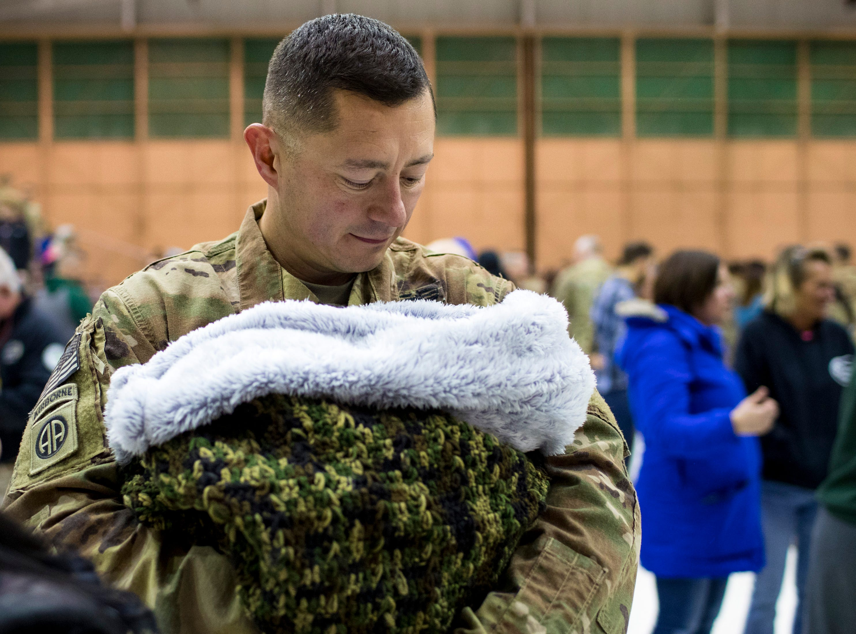 Sgt. Major Kevin Peterson holds his newborn son, Logan Grey Peterson, 1 week, for the first time, during the welcome home ceremony for the 2nd Battalion, 44th Air Defense Artillery Regiment and 101st Airborne Division at Fort Campbell in the early hours of Monday, Nov. 19, 2018. The soldiers were returning from a 9-month deployment in Afghanistan.