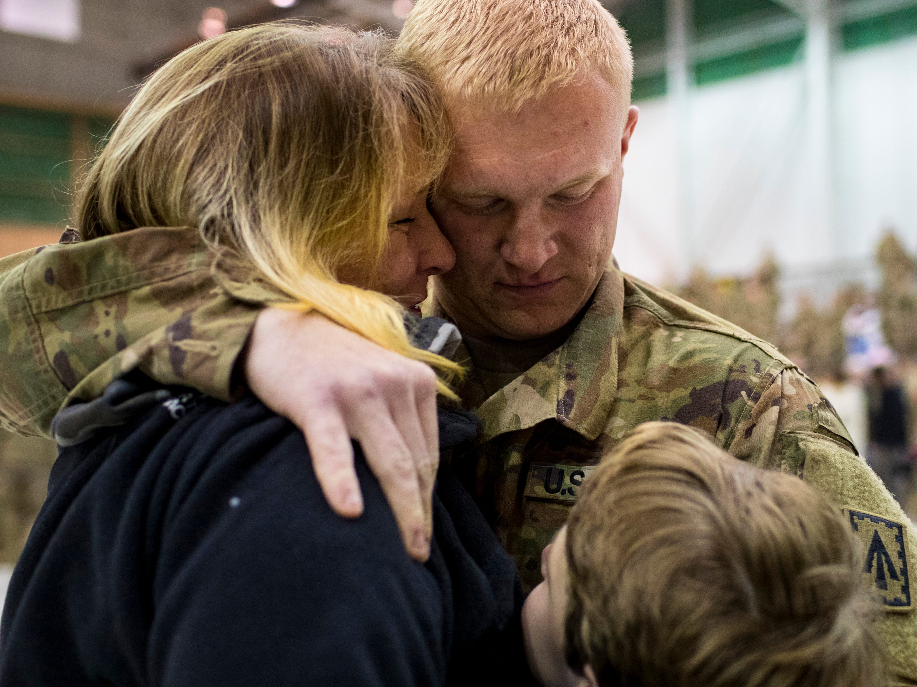 Nickolas Lack, Shawna Lack, and Nathan Lack, 11, embrace during the welcome home ceremony for the 2nd Battalion, 44th Air Defense Artillery Regiment and 101st Airborne Division at Fort Campbell in the early hours of Monday, Nov. 19, 2018. The soldiers were returning from a 9-month deployment in Afghanistan.