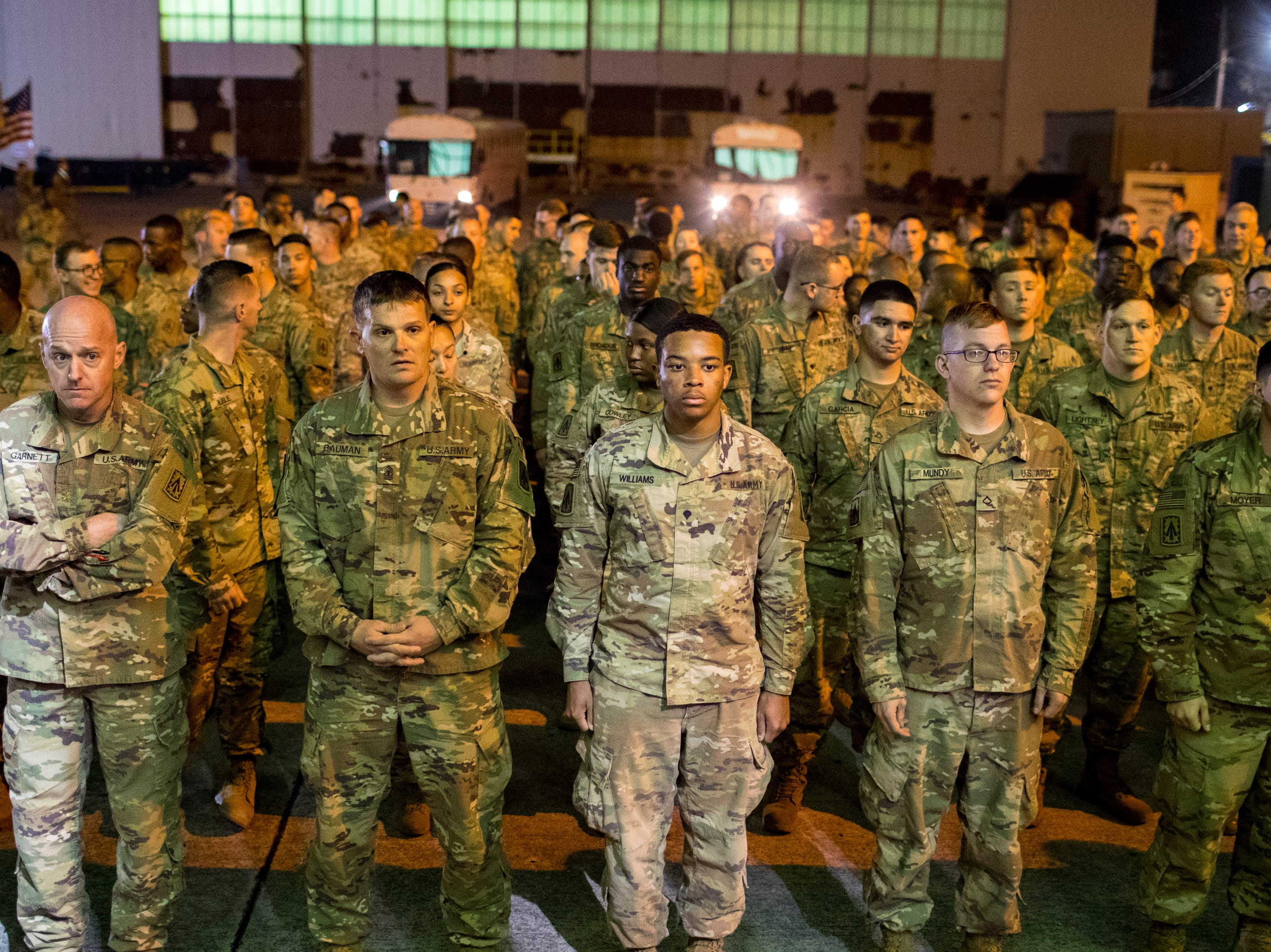 After dropping their weapons and packs the soldiers prepare to enter the welcome home ceremony for the 2nd Battalion, 44th Air Defense Artillery Regiment and 101st Airborne Division at Fort Campbell in the early hours of Monday, Nov. 19, 2018. The soldiers were returning from a 9-month deployment in Afghanistan.