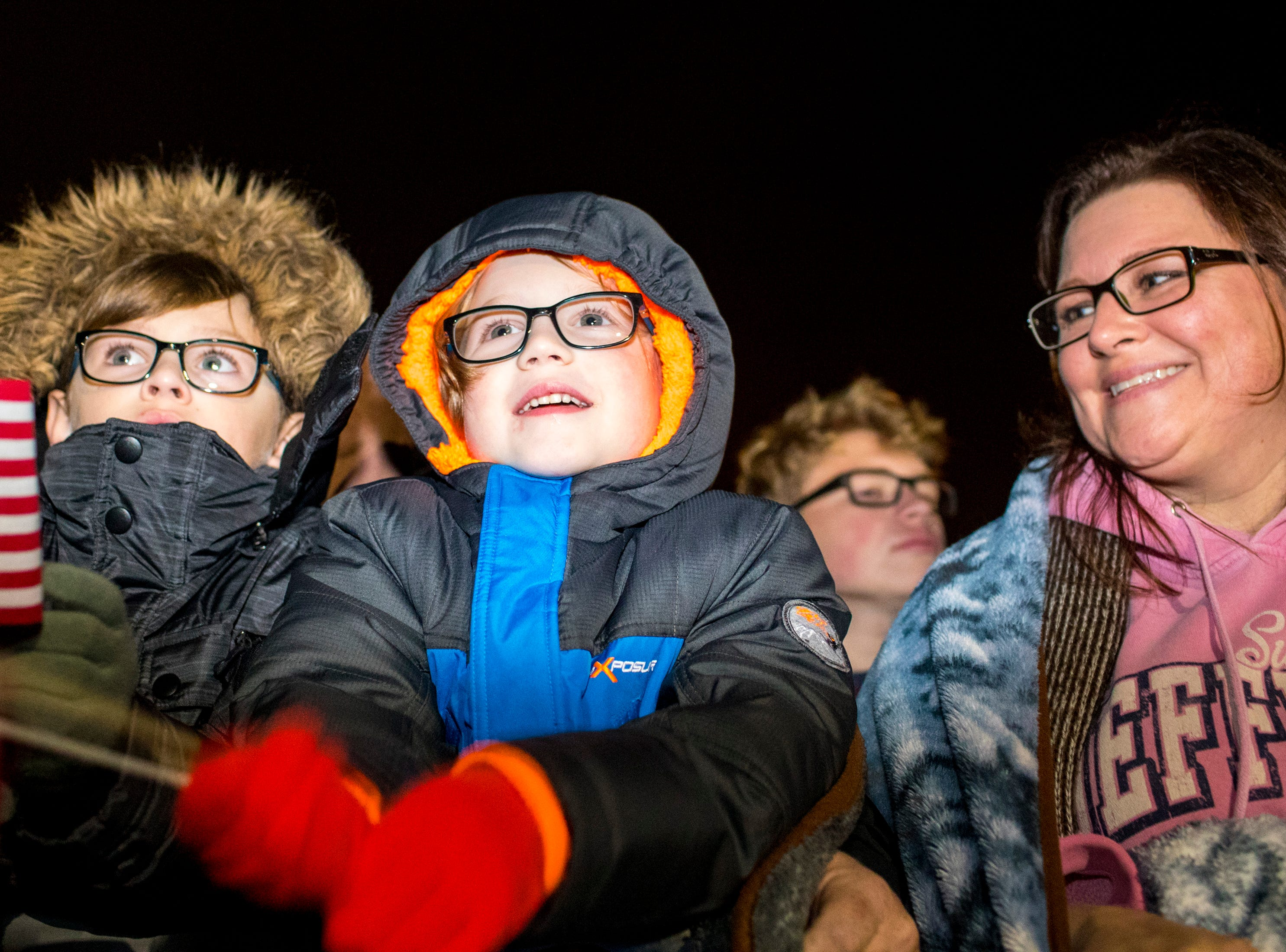 Hudsyn VanKirk, 6, prepares to welcome his uncle, Specialist Nick Green, during the welcome home ceremony for the 2nd Battalion, 44th Air Defense Artillery Regiment and 101st Airborne Division at Fort Campbell in the early hours of Monday, Nov. 19, 2018. The soldiers were returning from a 9-month deployment in Afghanistan.
