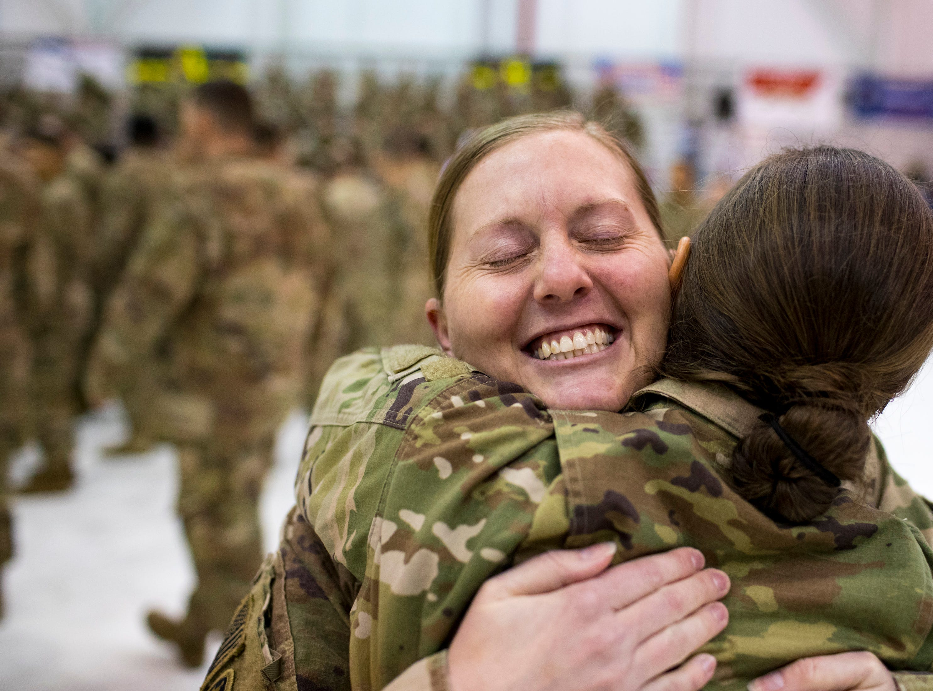 Capt. Dawn Moffett hugs Capt. Mary Jocelyn during the welcome home ceremony for the 2nd Battalion, 44th Air Defense Artillery Regiment and 101st Airborne Division at Fort Campbell in the early hours of Monday, Nov. 19, 2018. The soldiers were returning from a 9-month deployment in Afghanistan.