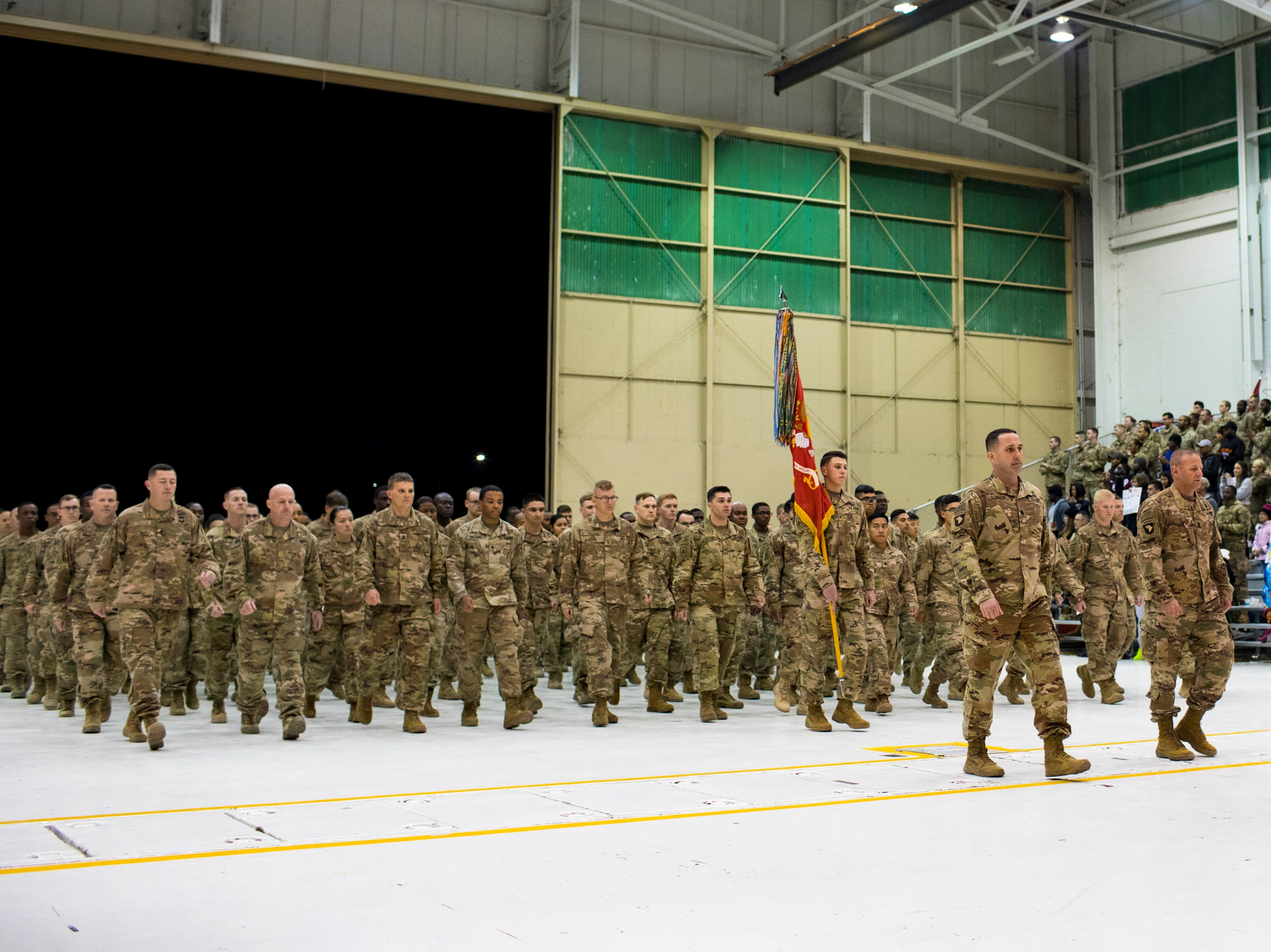 The soldiers enter the welcome home ceremony for the 2nd Battalion, 44th Air Defense Artillery Regiment and 101st Airborne Division at Fort Campbell in the early hours of Monday, Nov. 19, 2018. The soldiers were returning from a 9-month deployment in Afghanistan.