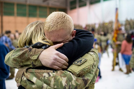 Nickolas Lack, and Shawna Lack embrace during the welcome home ceremony for the 2nd Battalion, 44th Air Defense Artillery Regiment and 101st Airborne Division at Fort Campbell in the early hours of Monday, Nov. 19, 2018. The soldiers were returning from a 9-month deployment in Afghanistan.