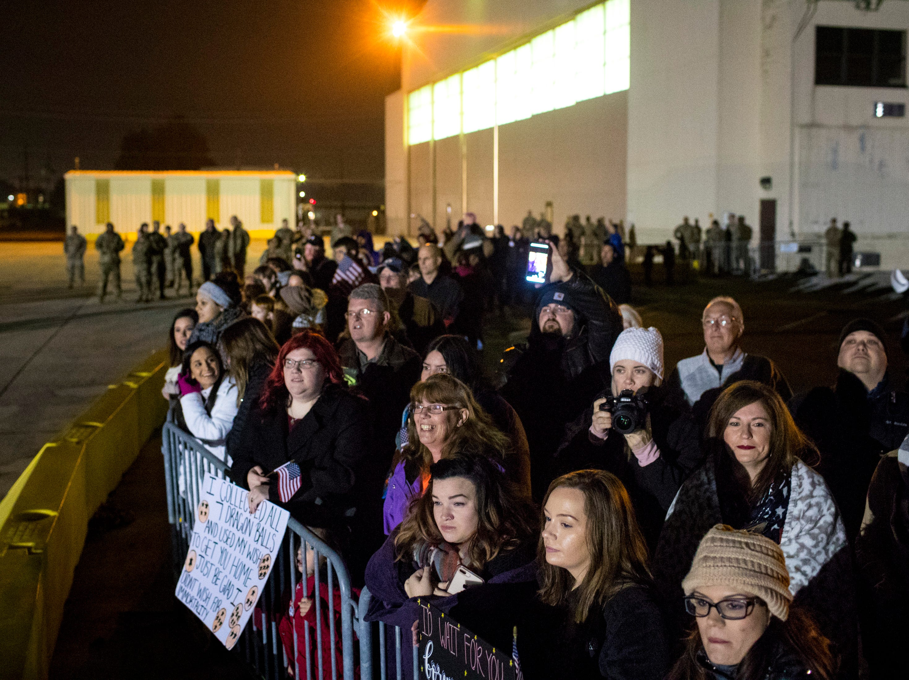 Friends and family members wait to greet their loved ones during the welcome home ceremony for the 2nd Battalion, 44th Air Defense Artillery Regiment and 101st Airborne Division at Fort Campbell in the early hours of Monday, Nov. 19, 2018. The soldiers were returning from a 9-month deployment in Afghanistan.