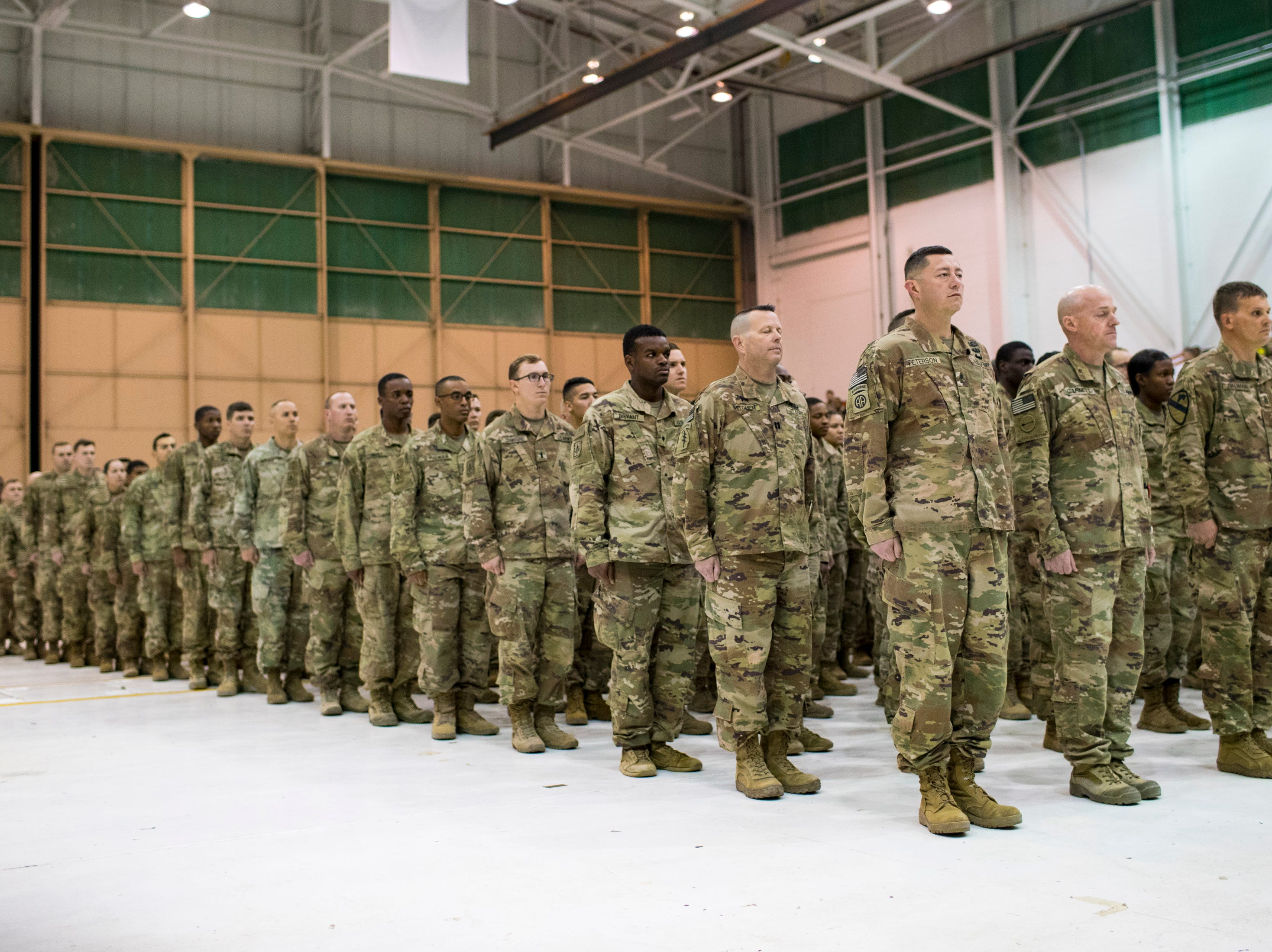 The soldiers stand in formation during the welcome home ceremony for the 2nd Battalion, 44th Air Defense Artillery Regiment and 101st Airborne Division at Fort Campbell in the early hours of Monday, Nov. 19, 2018. The soldiers were returning from a 9-month deployment in Afghanistan.
