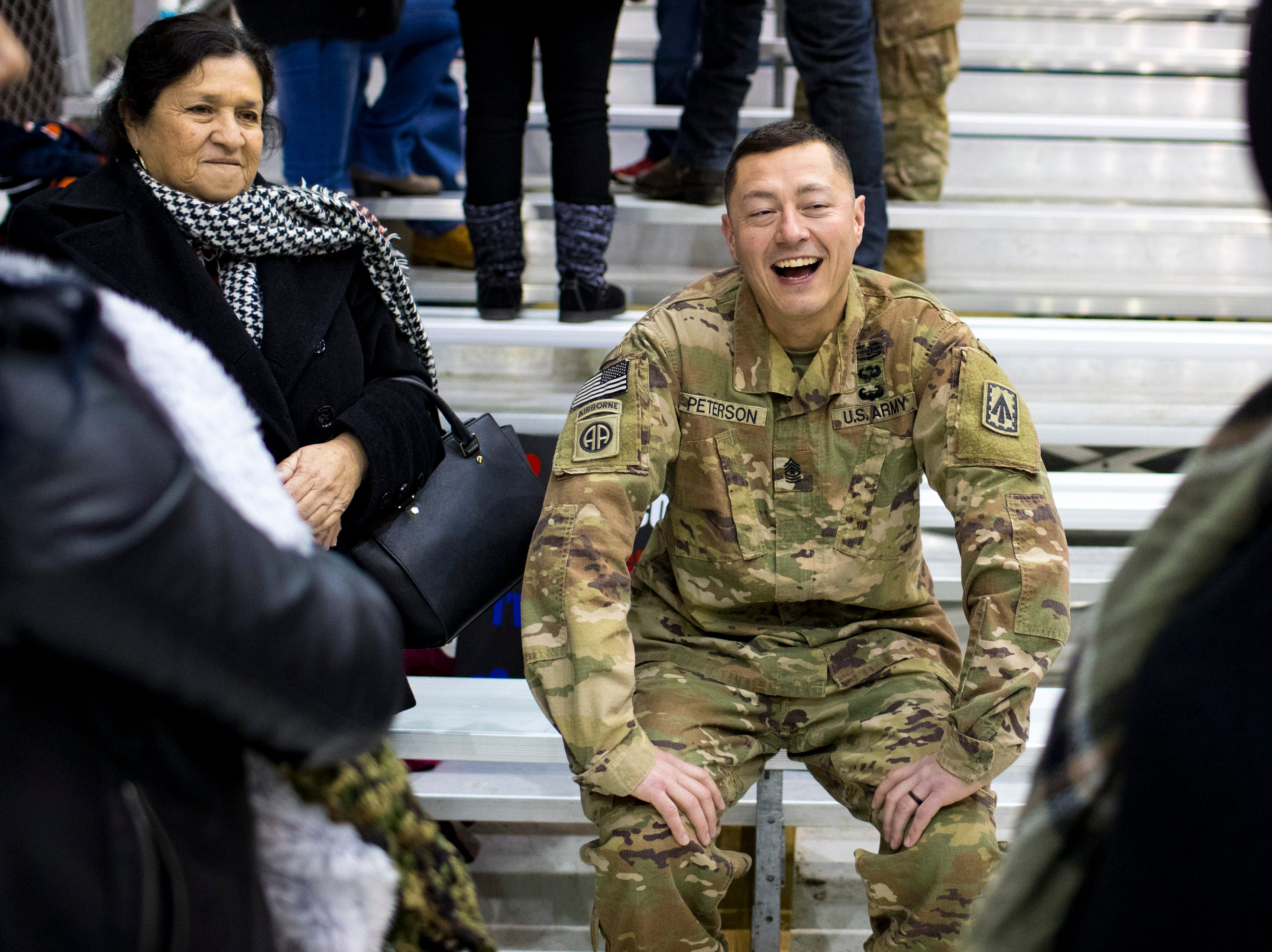 Sgt. Major Kevin Peterson talks to his family during the welcome home ceremony for the 2nd Battalion, 44th Air Defense Artillery Regiment and 101st Airborne Division at Fort Campbell in the early hours of Monday, Nov. 19, 2018. The soldiers were returning from a 9-month deployment in Afghanistan.