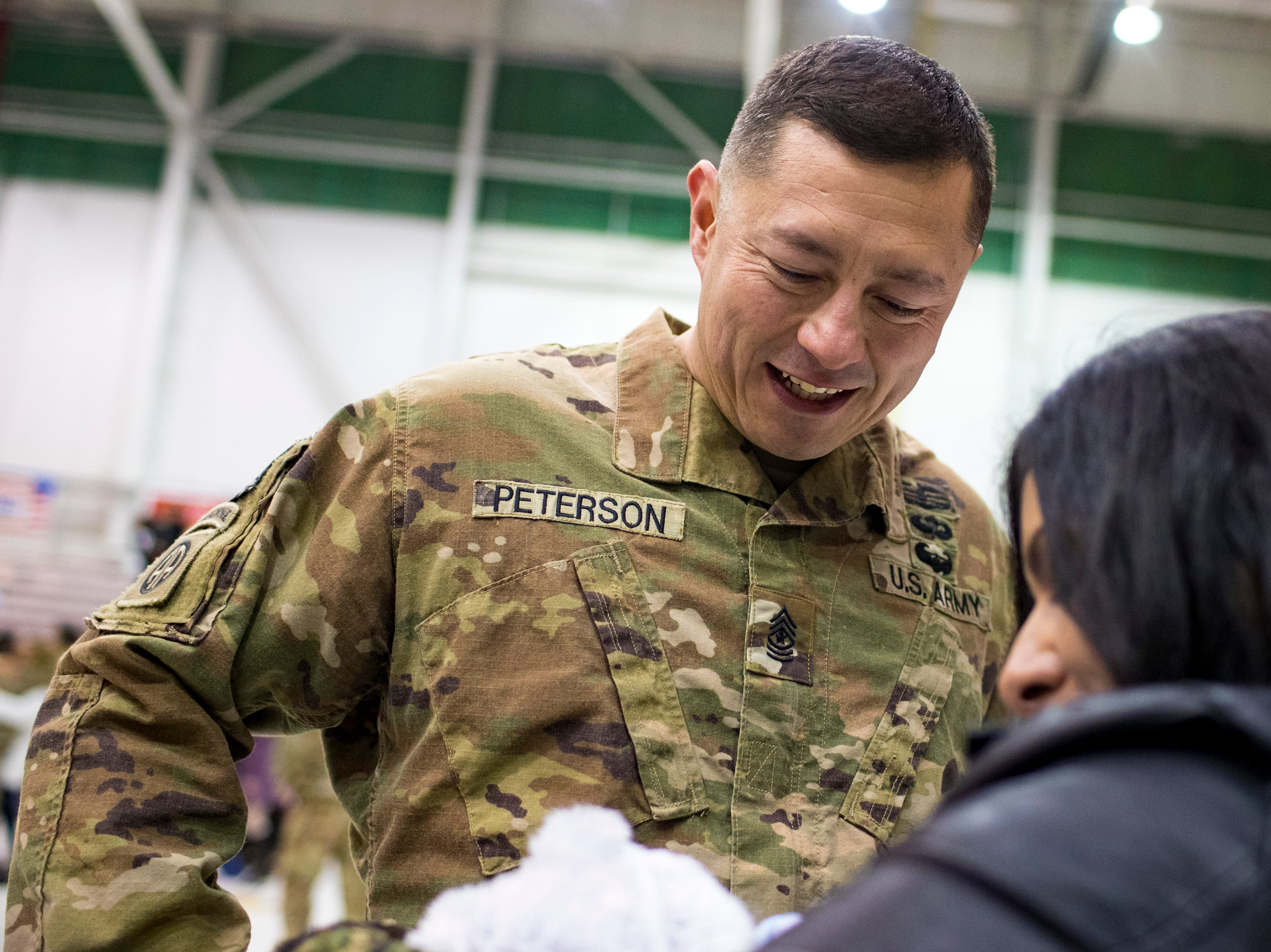 Sgt. Major Kevin Peterson sees his newborn son, Logan Grey Peterson, 1 week, for the first time, during the welcome home ceremony for the 2nd Battalion, 44th Air Defense Artillery Regiment and 101st Airborne Division at Fort Campbell in the early hours of Monday, Nov. 19, 2018. The soldiers were returning from a 9-month deployment in Afghanistan.