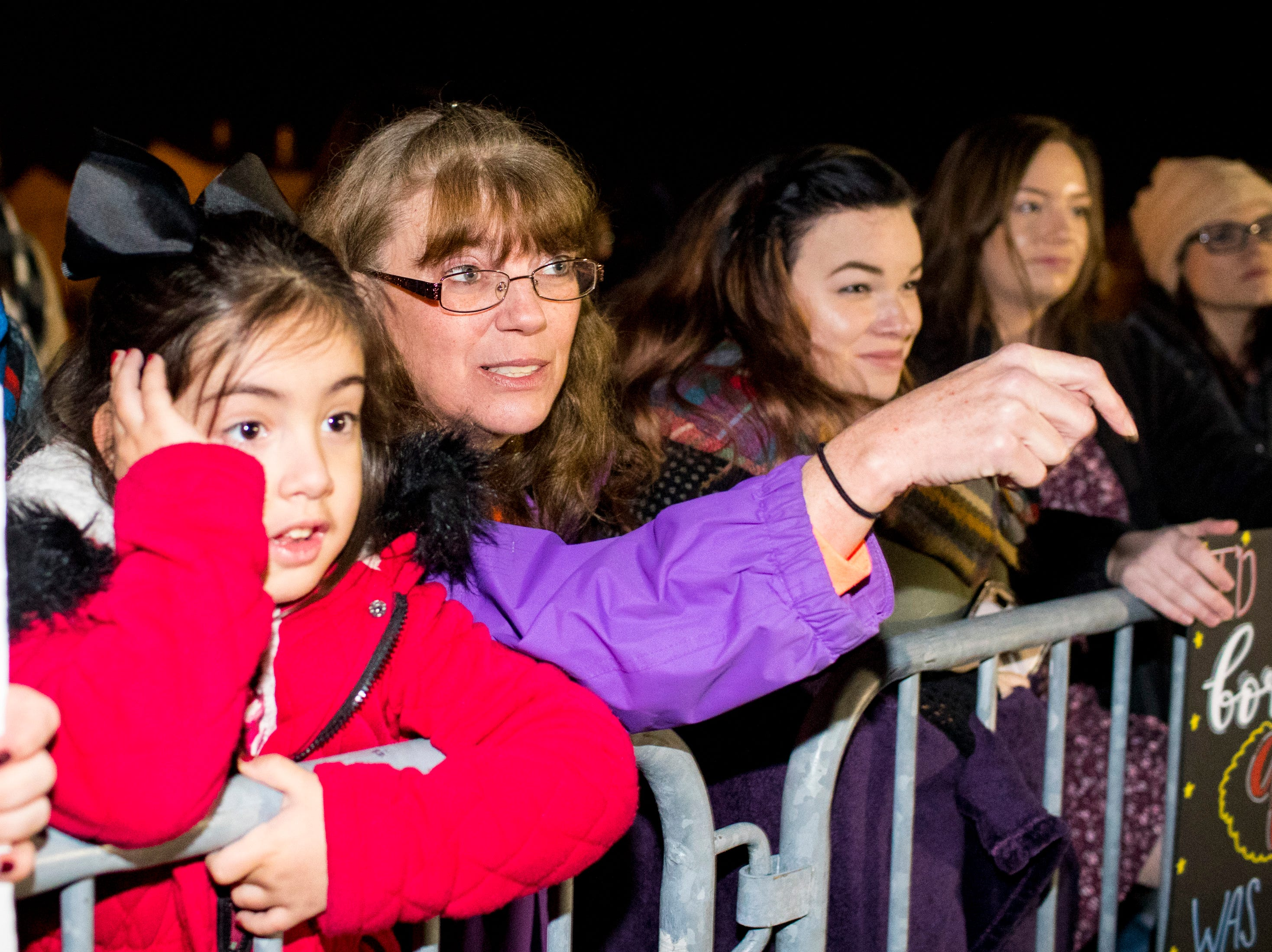 Jennifer King points her granddaughter, Sophia Blais, 5, towards the plane carrying Blais' uncle, Specialist Jordan Rogers, during the welcome home ceremony for the 2nd Battalion, 44th Air Defense Artillery Regiment and 101st Airborne Division at Fort Campbell in the early hours of Monday, Nov. 19, 2018. The soldiers were returning from a 9-month deployment in Afghanistan.