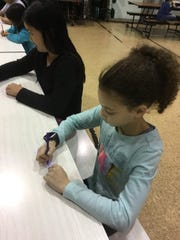"Students in Woodbridge School District's after-care program are participating in the ""I Give a Hoot-Giving"" program that combines fun Thanksgiving-themed arts and crafts activities and educational programming, with the collection of non perishable food donations for the Helping Hands Foundation."