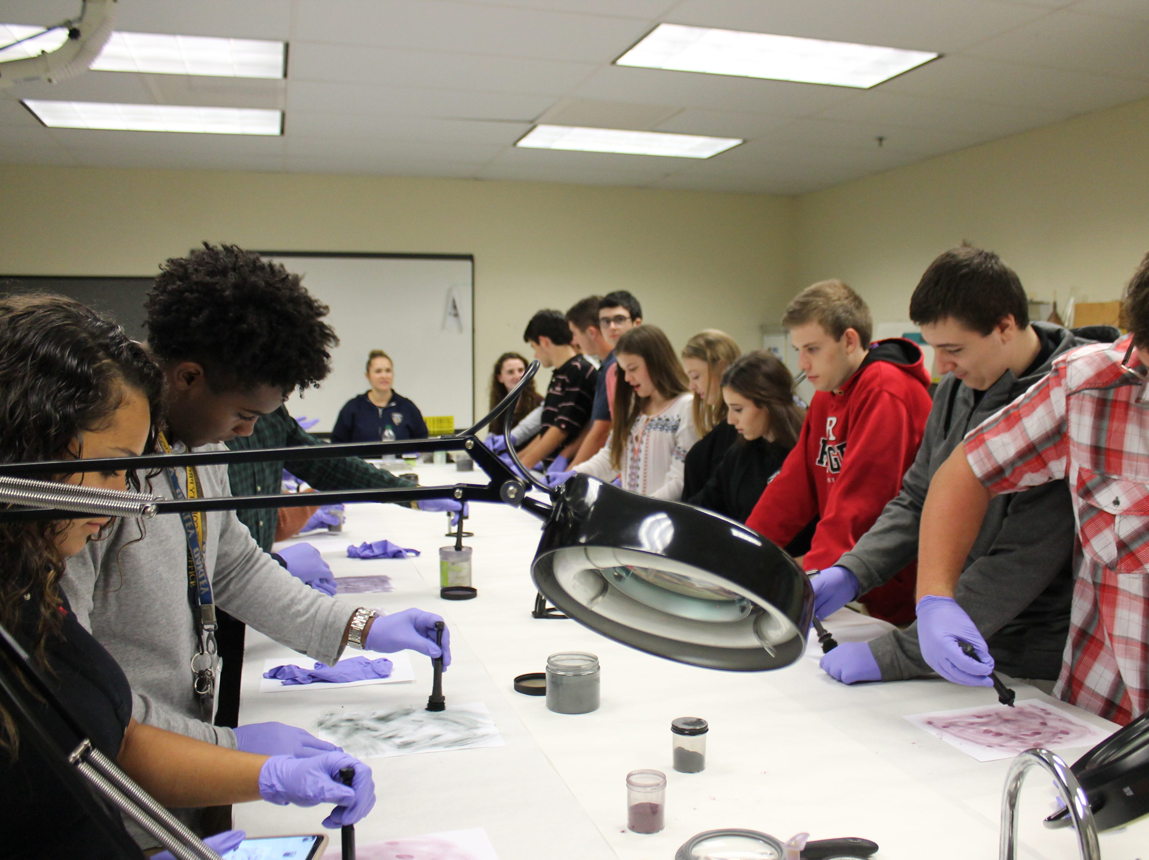 Students spent time dusting fingerprints and identifying the different types of fingerprint classifications.