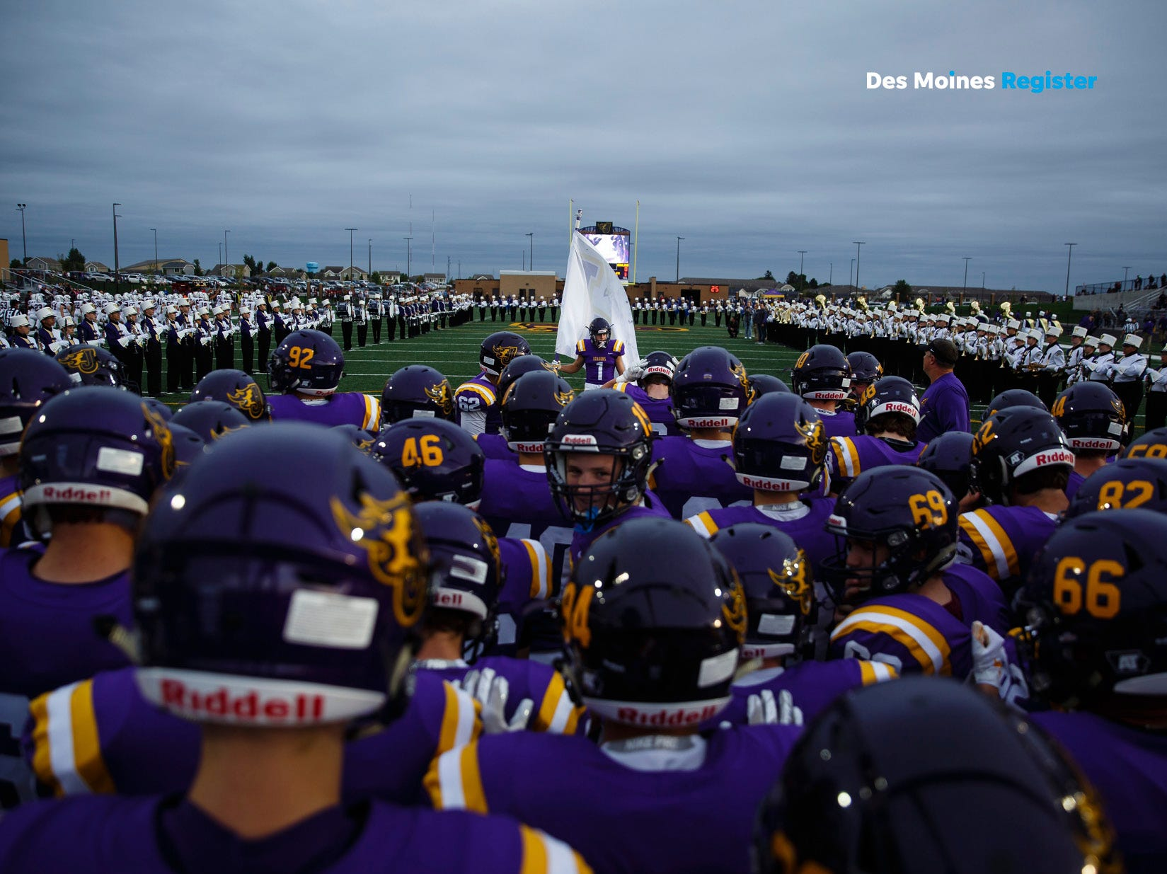 "<b>September: </b>The Johnston football team takes the field before a home game against Dowling Catholic. The Register's 2019 photo calendar is available for $18 at <a href=""https://shopdmregister.com/collections/photo-gifts/products/2019-des-moines-register-photo-calendar?utm_source=desmoinesregister&utm_medium=link&utm_campaign=launch_gallery"" target=""_blank"">ShopDMRegister.com. </a>"