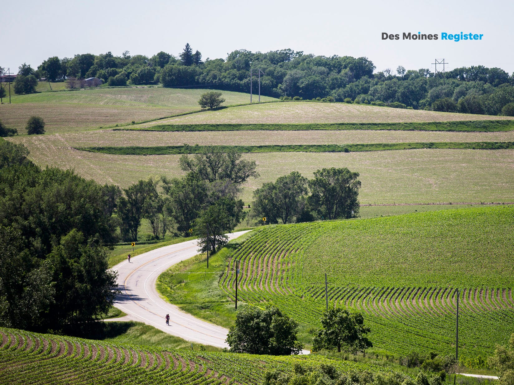 "<b>June: </b>Riders climb hills outside of Denison on Day 1 of the 2018 RAGBRAI Pre-Ride Route Inspection. The Register's 2019 photo calendar is available for $18 at <a href=""https://shopdmregister.com/collections/photo-gifts/products/2019-des-moines-register-photo-calendar?utm_source=desmoinesregister&utm_medium=link&utm_campaign=launch_gallery"" target=""_blank"">ShopDMRegister.com. </a>"