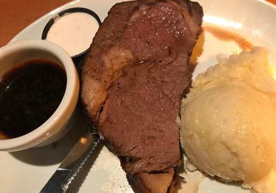A medium-rare prime rib with garlic mashed potatoes at The Urban Grill in Urbandale.