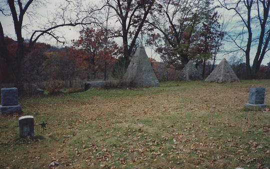 These three pyramids at Hickory Grove Cemetery were commissioned by Avery, Iowa, publisher Axel Peterson, who wanted to be buried inside the largest one upon his death. He was buried in a different cemetery instead.