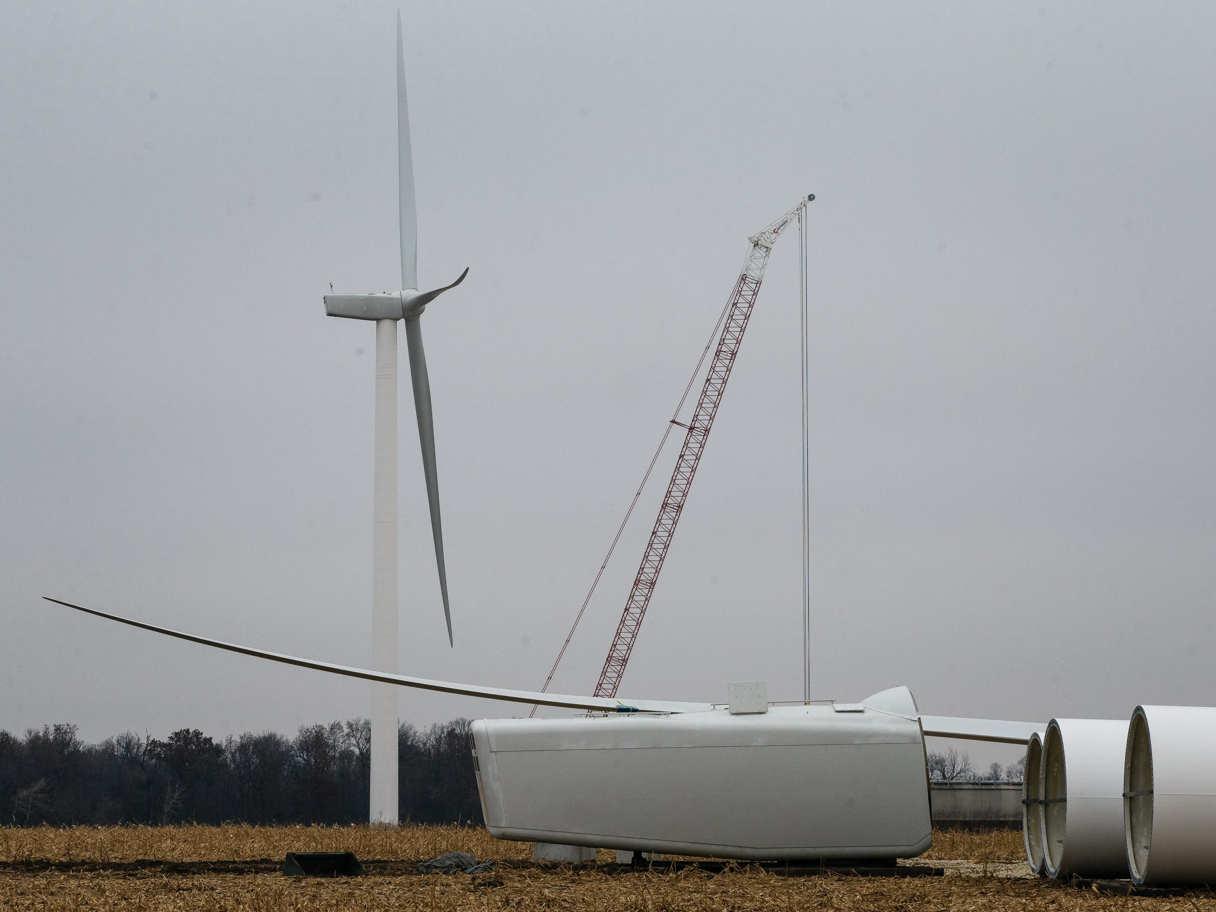 One of three wind turbines sits deconstructed in a field outside of Fairbank on Friday, Nov. 16, 2018. A district court judge ordered three wind turbines to be dismantled after deciding that Fayette county provided the developers permits illegally in 2014 who now have until December 9th to bring them all down.