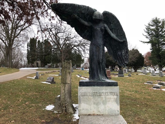 The Black Angel presides over this section of Oakland Cemetery in Iowa City. The large bronze statue was sculpted in Chicago and erected here in 1913 as a memorial to Nicholas Feldevert.