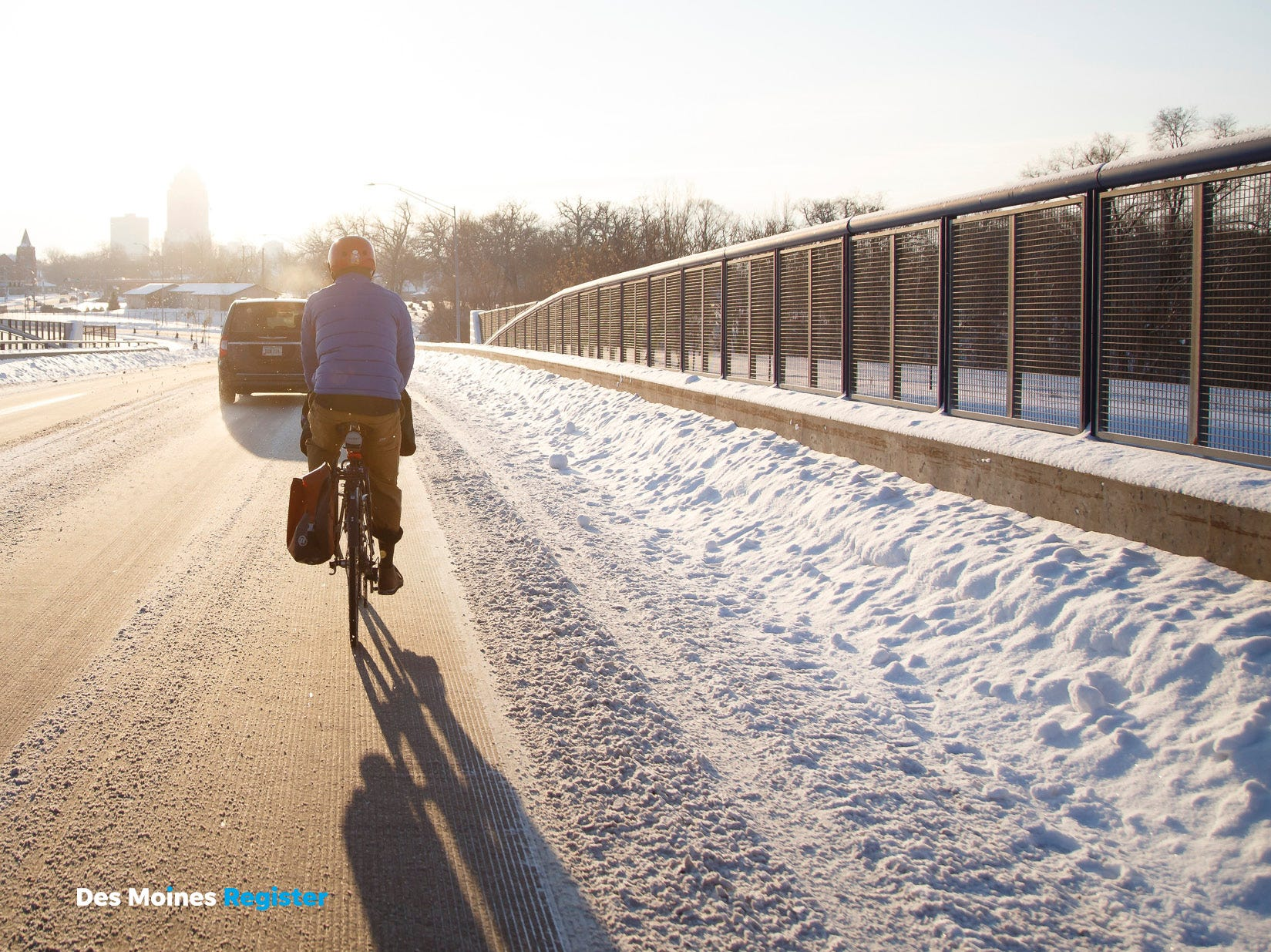 "<b>February: </b> A cyclist rides along Cottage Grove Avenue in Des Moines. The Register's 2019 photo calendar is available for $18 at <a href=""https://shopdmregister.com/collections/photo-gifts/products/2019-des-moines-register-photo-calendar?utm_source=desmoinesregister&utm_medium=link&utm_campaign=launch_gallery"" target=""_blank"">ShopDMRegister.com. </a>"