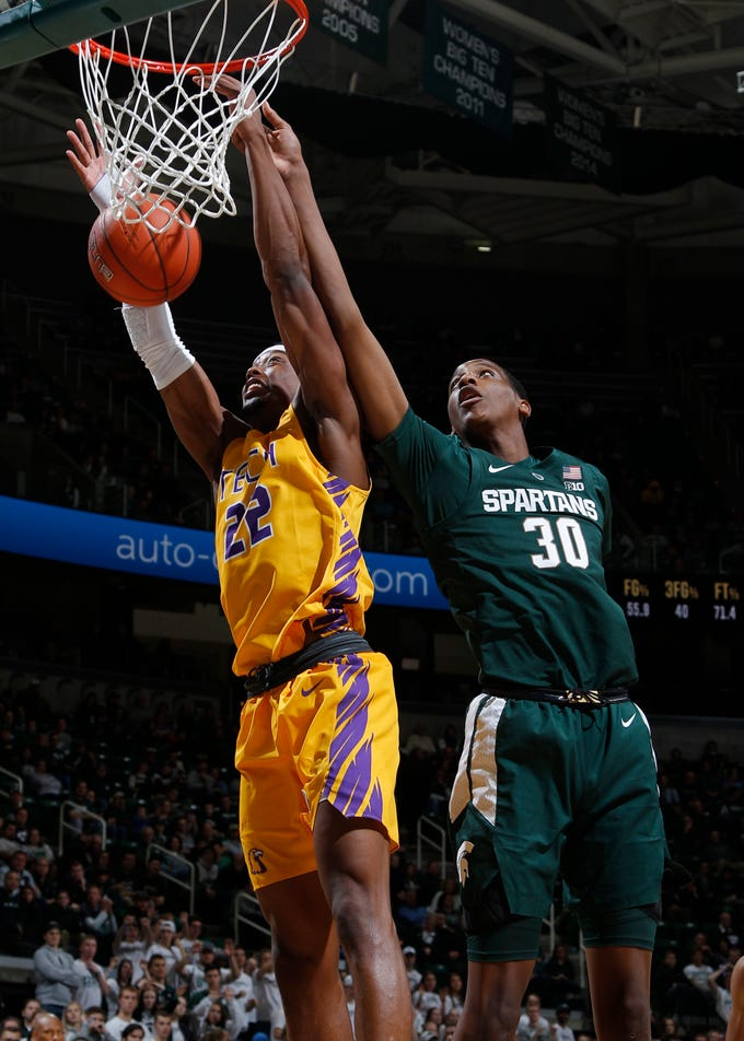 Tennessee Tech's Courtney Alexander II, left, grabs a rebound against Michigan State's Marcus Bingham Jr. (30) during the second half of MSU's 101-33 win on Sunday, Nov. 18, 2018, in East Lansing.