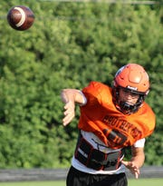 Brother Rice quarterback Greg Piscopink unleashes a pass during a recent practice.