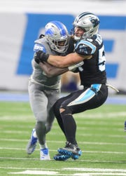 Kerryon Johnson is tackled by Panthers linebacker Luke Kuechly, Nov. 18 at Ford Field.
