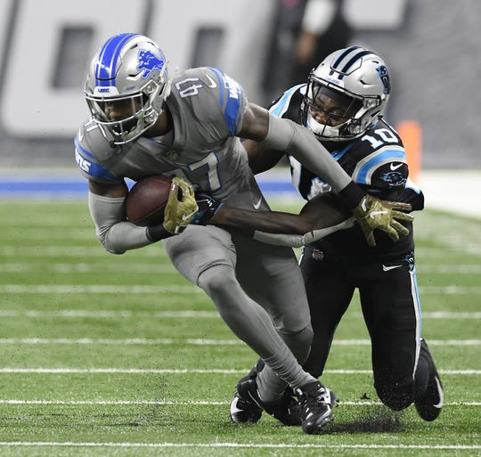 Detroit Lions defensive back Tracy Walker intercepts a pass against Carolina Panthers receiver Curtis Samuel in the second quarter Sunday, Nov. 18, 2018 at Ford Field.