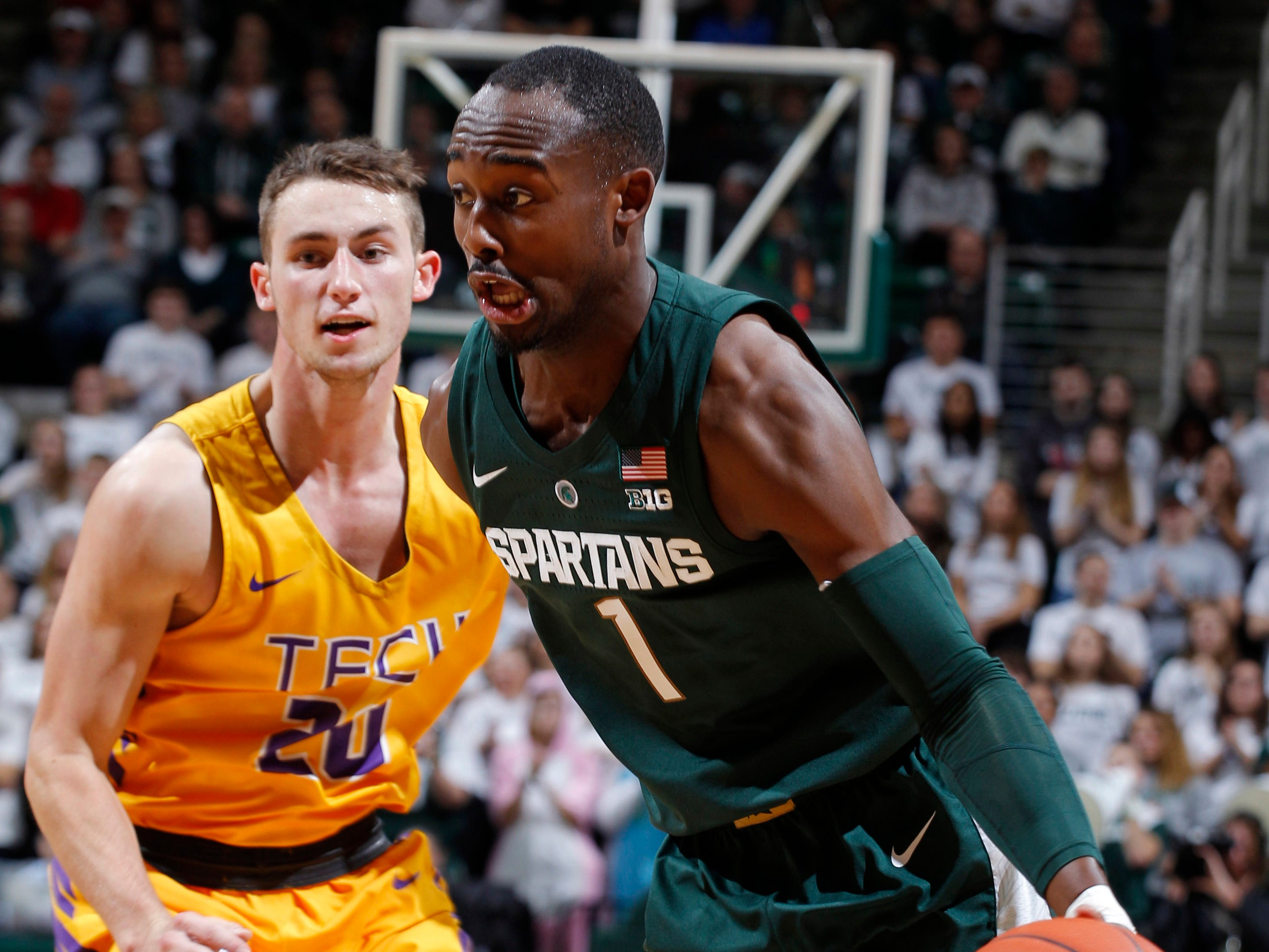 Michigan State's Joshua Langford, right, drives against Tennessee Tech's Hunter Vick during the first half of MSU's 101-33 win on Sunday, Nov. 18, 2018, in East Lansing.