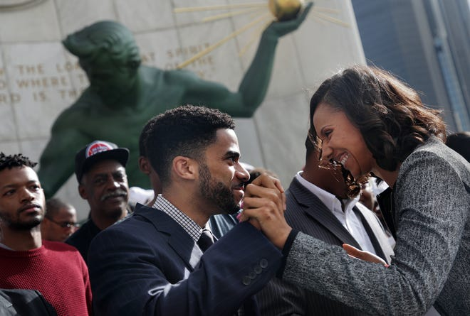 Detroit City Council President Pro Te Mary Sheffield, right, and Damion Ellis high five during the introduction of legislation called the People's Bills  Sept.17, 2018, in front of the Coleman A. Young Municipal Center in Detroit.