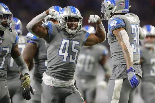 Detroit Lions DB Charles Washington celebrates a tackle on Carolina Panthers running back Christian McCaffrey during the second half Sunday, November 18, 2018 at Ford Field.
