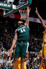 Michigan State's Nick Ward (44) gets a reverse layup against Tennessee Tech during the first half of MSU's 101-33 win on Sunday, Nov. 18, 2018, in East Lansing.