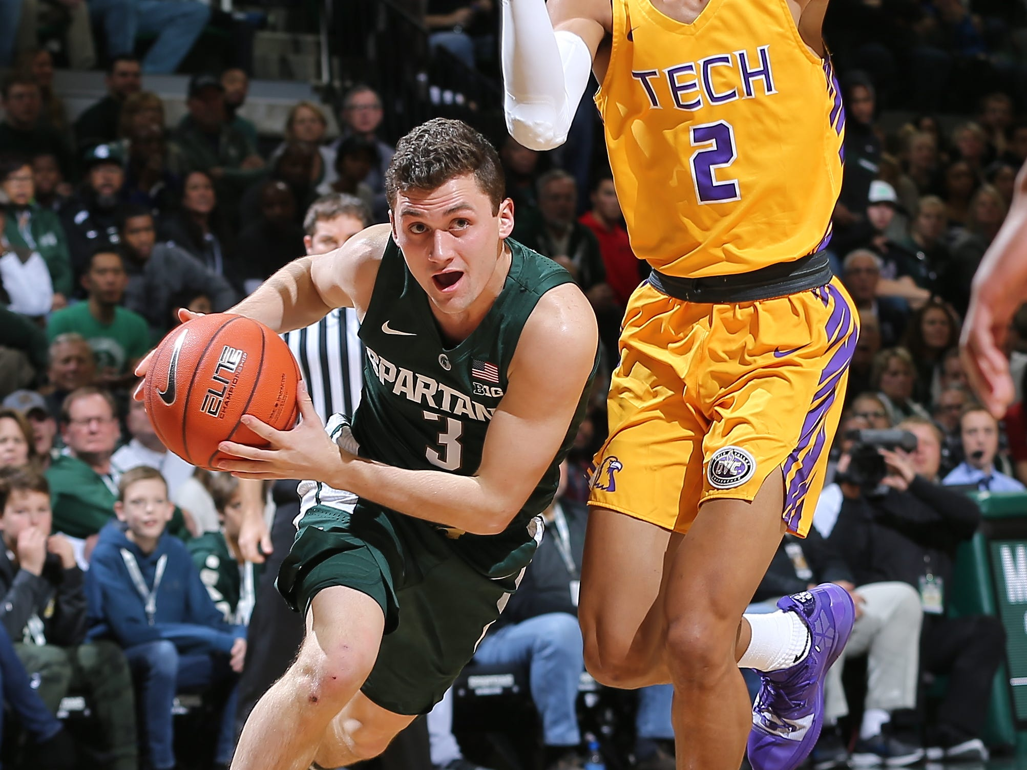Michigan State's Foster Loyer drives to the basket against Jared Sherfield of Tennessee Tech in the first half at Breslin Center on Nov. 18, 2018 in East Lansing.