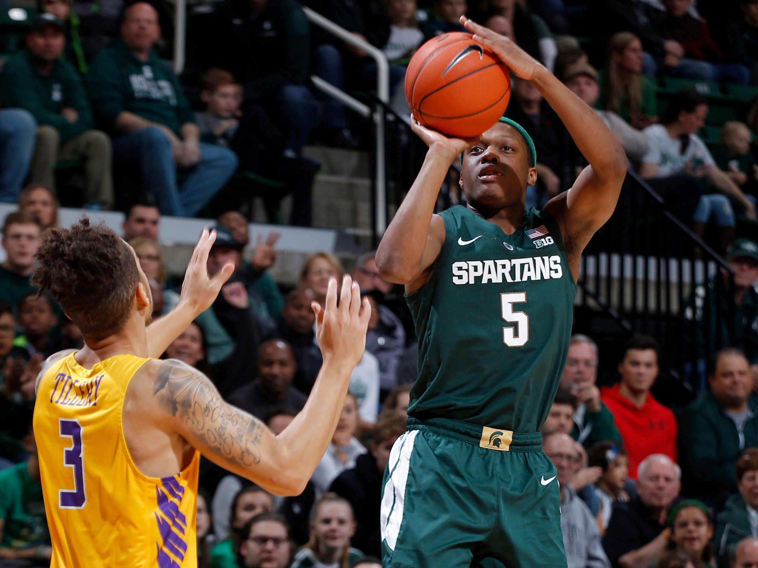 Michigan State's Cassius Winston, right, shoots against Tennessee Tech's Corey Tillery (3) during the first half of MSU's 101-33 win on Sunday, Nov. 18, 2018, in East Lansing.