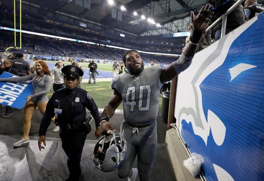 Detroit Lions LB Jarrad Davis celebrates with Lions fans, after the win over the Panthers, 20-19, at Ford Field on Nov. 18, 2018.