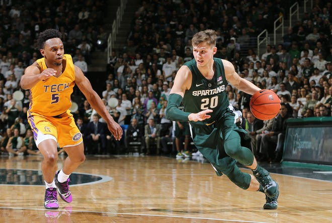Michigan State's Matt McQuaid drives past Johnnie Vassar of Tennessee Tech in the first half at Breslin Center on Nov. 18, 2018 in East Lansing.