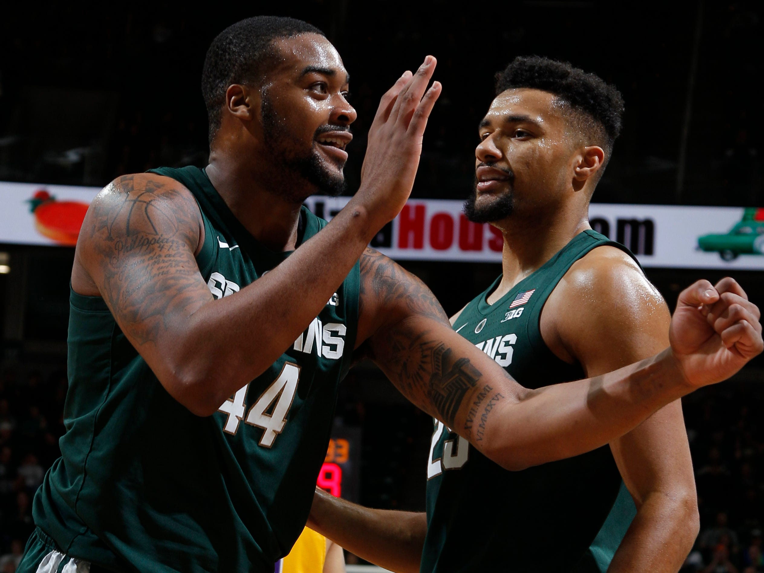 Michigan State's Nick Ward, left, celebrates during the second half of MSU's 101-33 win on Sunday, Nov. 18, 2018, in East Lansing.