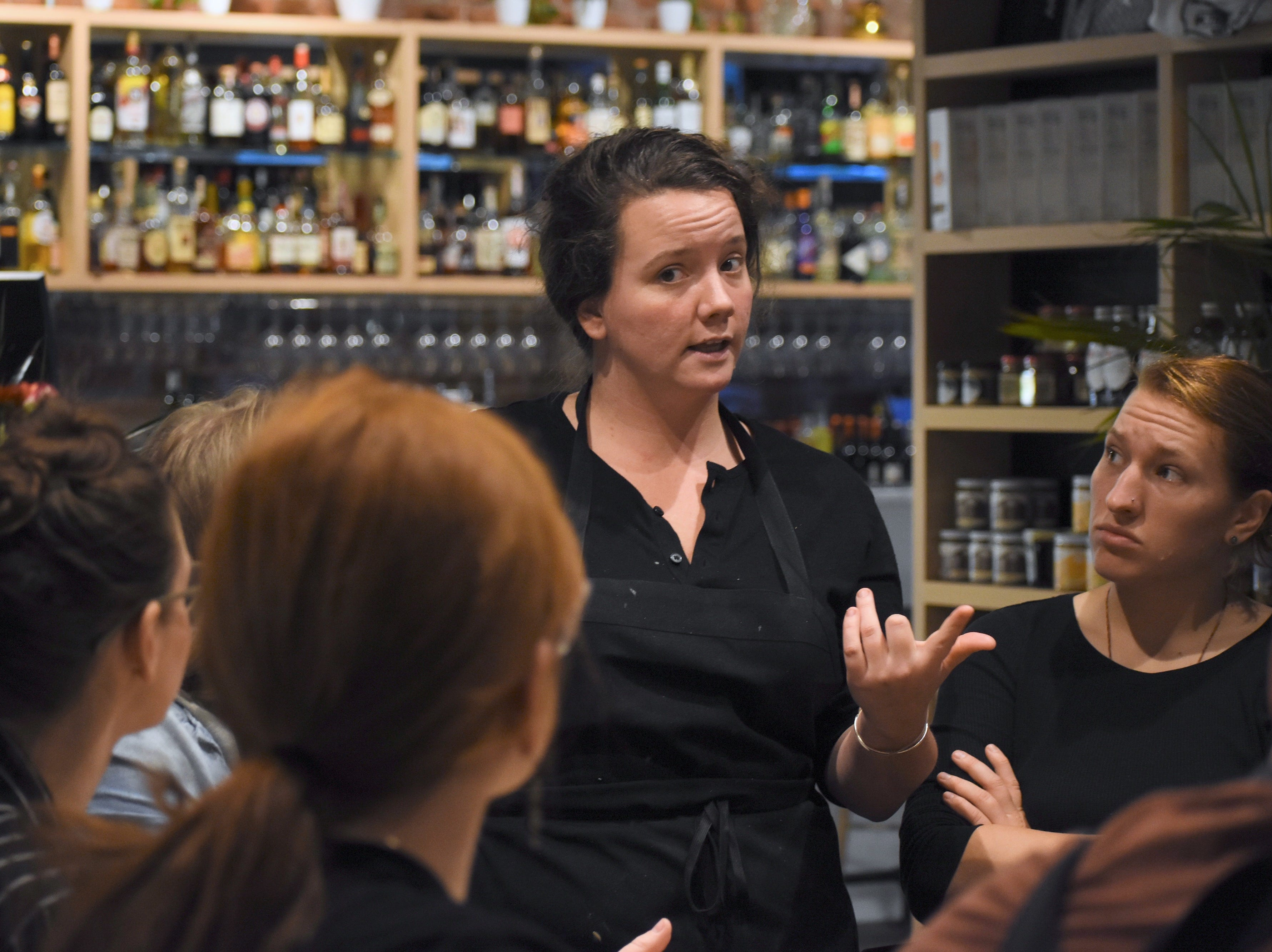 "Executive Chef / Partner Sarah Welch, center, briefs her staff on the night's adventures.   Executive Chef / Partner Sarah Welch and her all-female crew craft dishes like pork belly with apple butter, Brussel sprouts and sauerkraut  or  shrimp and pork bone broth with shrimp dumplings and a duck egg at the new hyper-seasonal meat-centric eatery called ""Marrow"" in Detroit, Michigan on November 17, 2018. The restaurant, in the city's West Village neighborhood, boasts an attached butcher shop that sells meats, house-made bone broth and other goodies. (Brandy Baker / Special to the Detroit News)"
