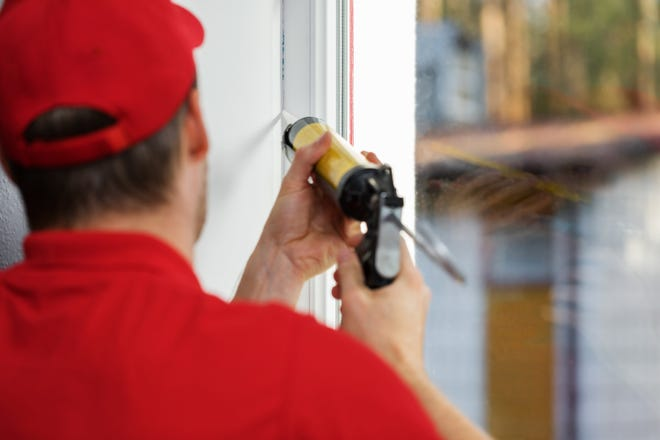 Sealing windows and doors with caulk or weather stripping offers the first line of defense against air loss. (Dreamstime)